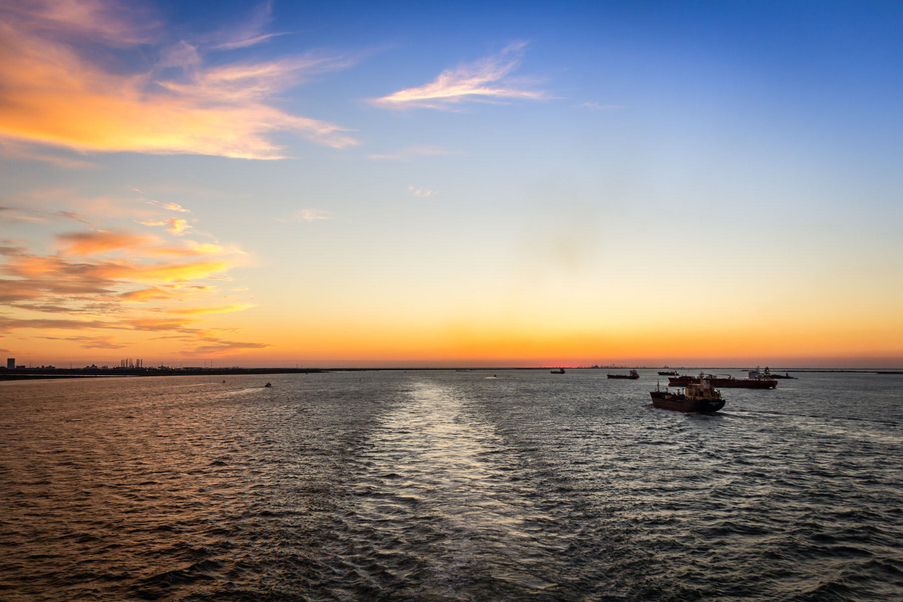 The sun sets on Galveston Bay, Texas, as seen from the deck of the Carnival Triumph.