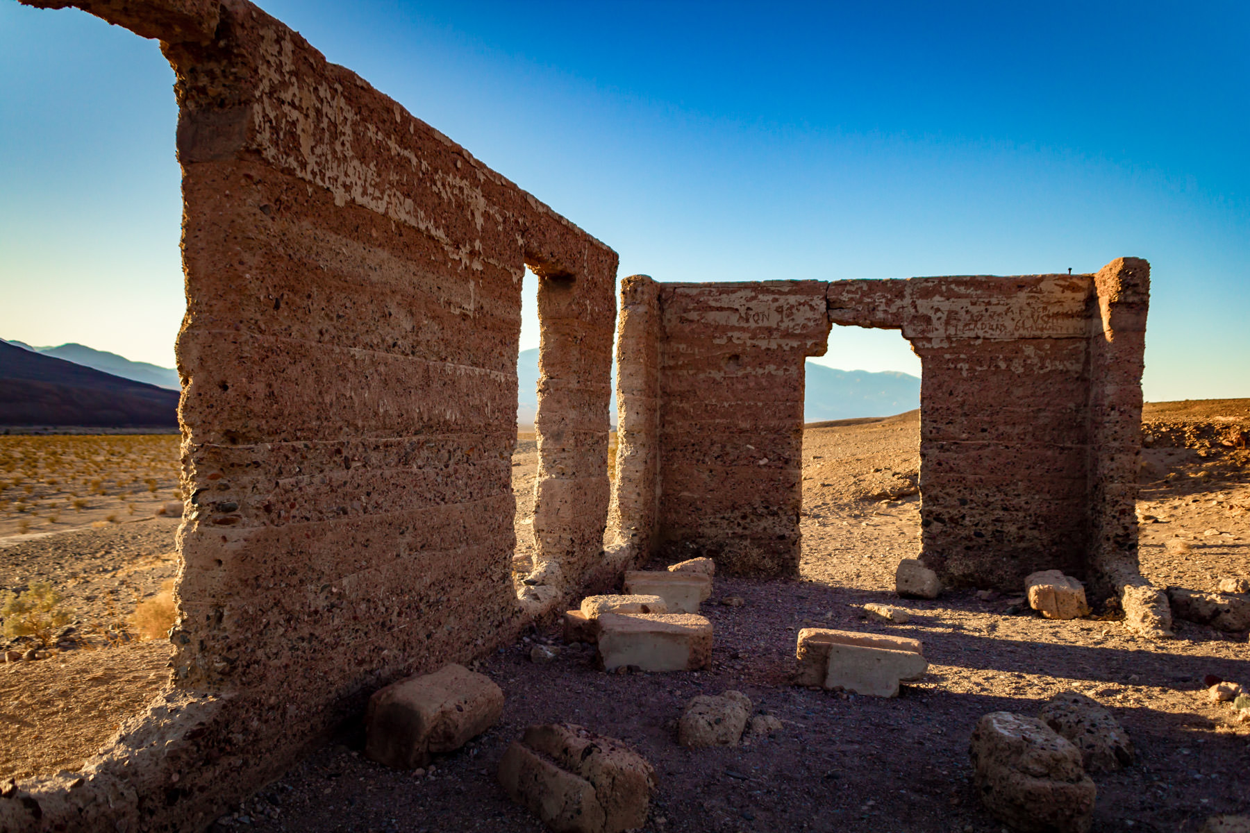 Exploring the Ashford Mill ruins as the sun sets in Death Valley National Park, California.