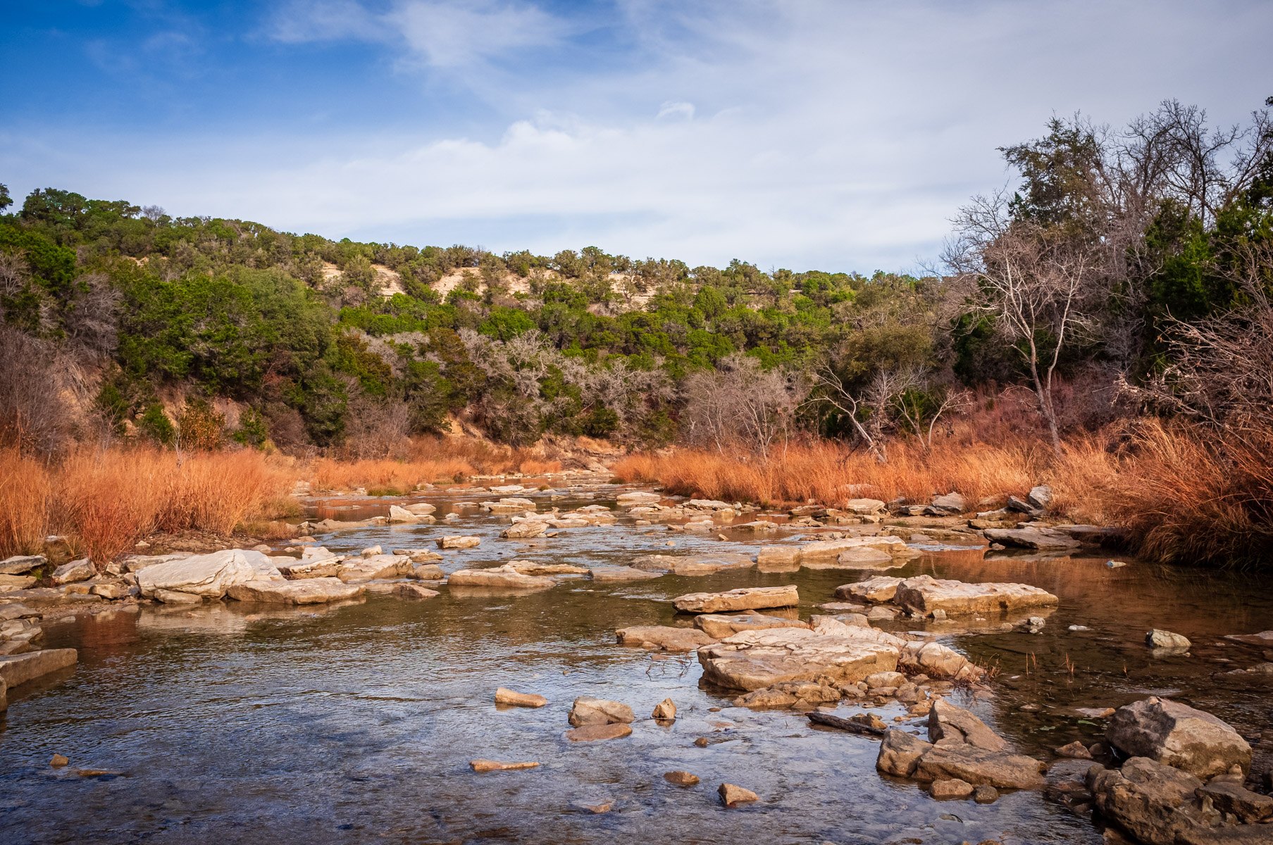 The Paluxy River flows through the highlands near Glen Rose, Texas at Dinosaur Valley State Park.