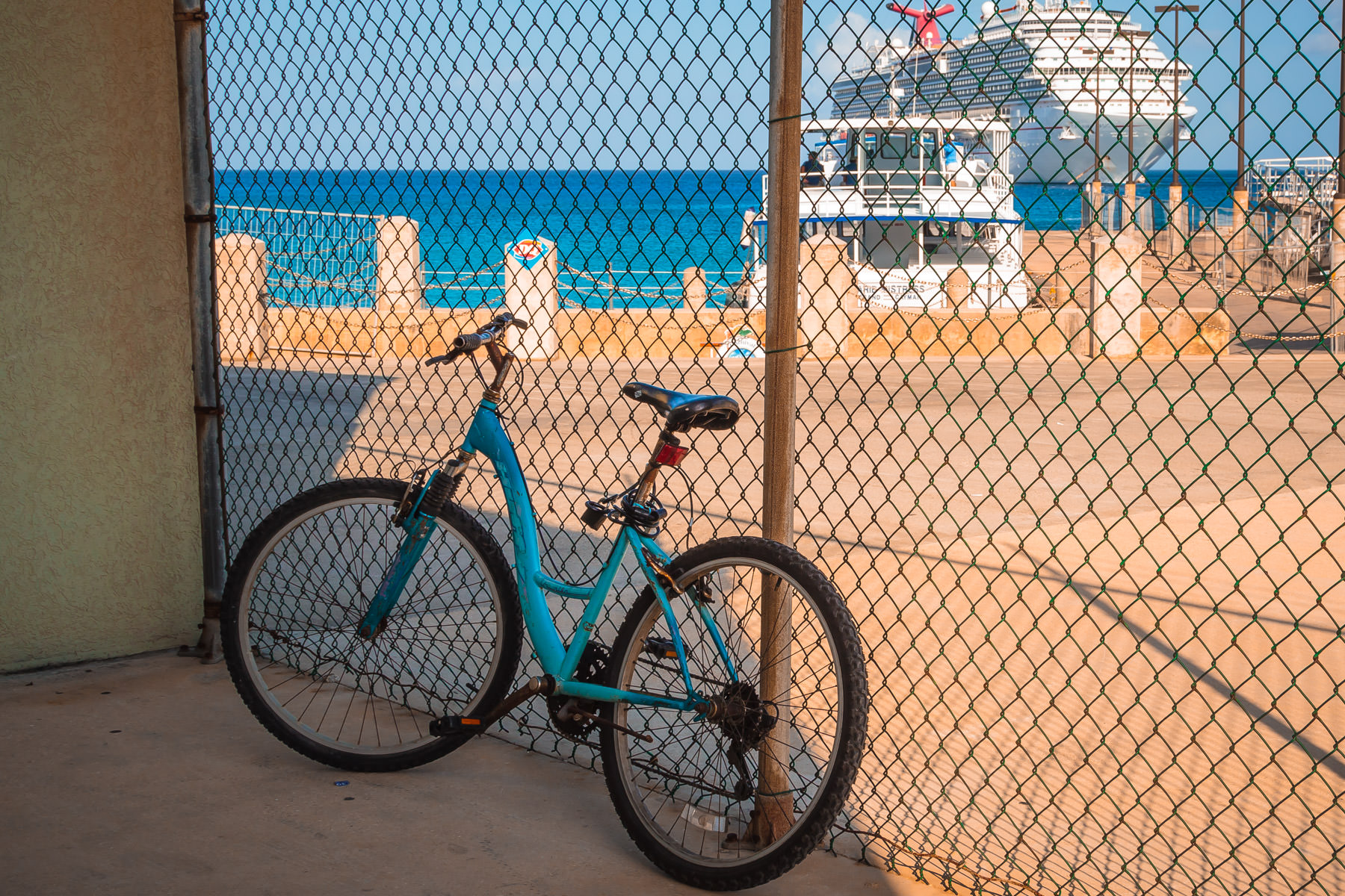 A bicycle leans against a fence in George Town, Grand Cayman.