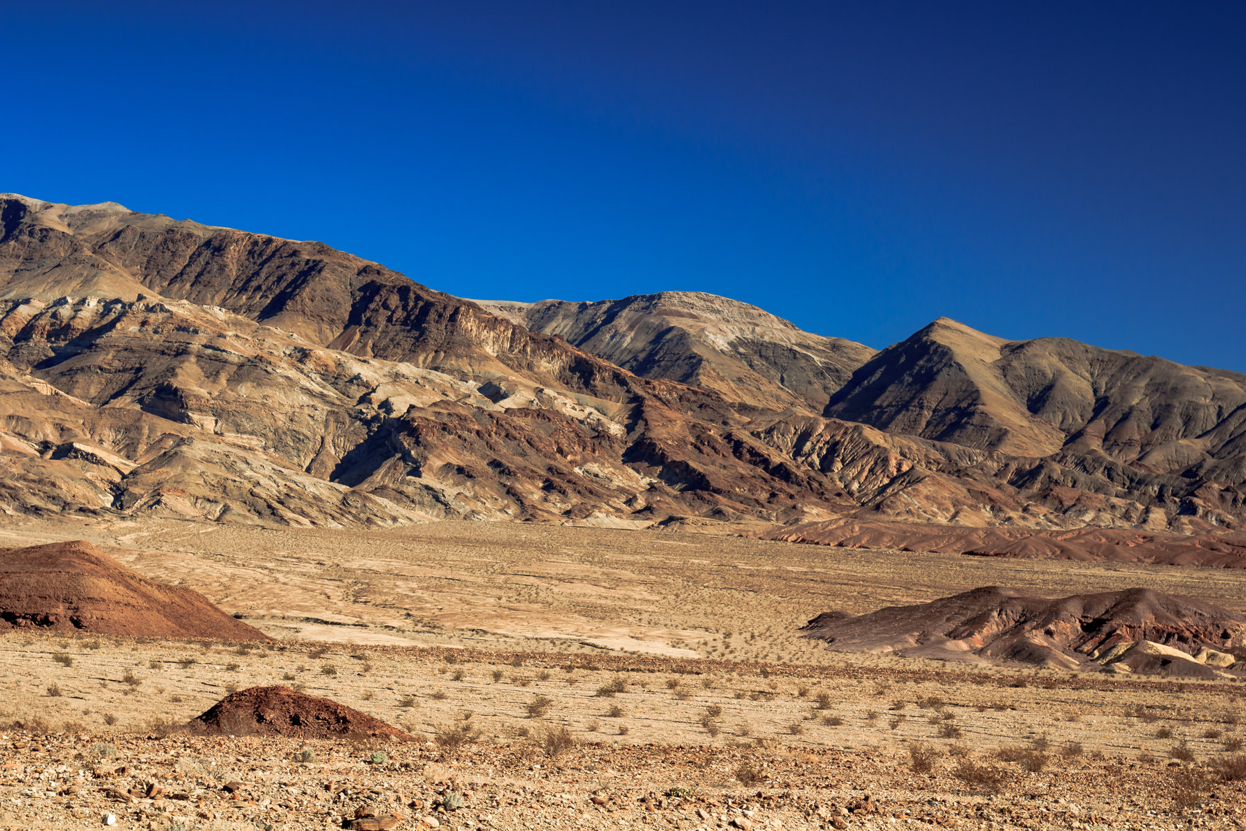 Mountains rise from the floor of the desert at Death Valley National Park, California.