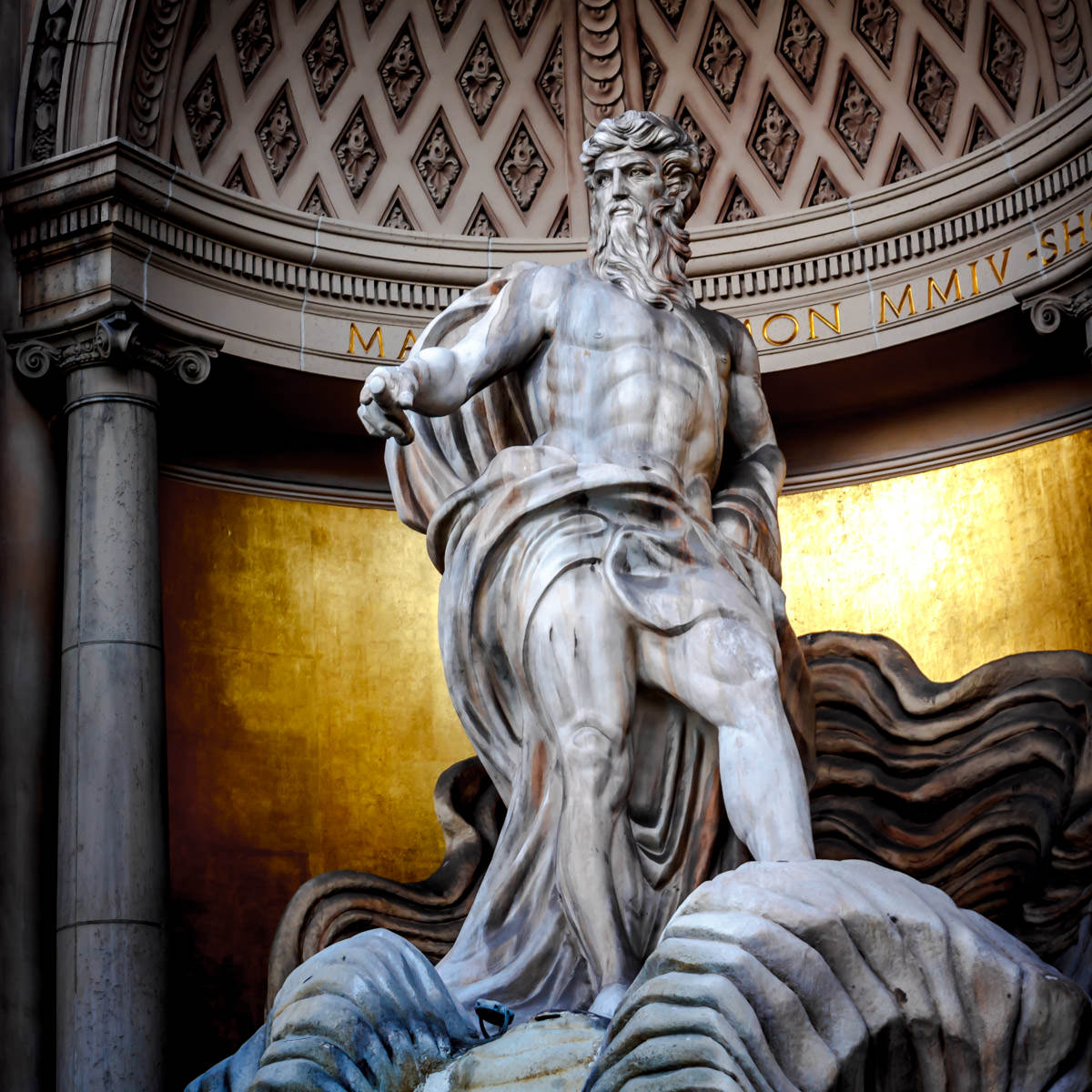 A statue of the Roman god of the sea, Neptune, known as Poseidon to the Greeks, stands in a replica of Rome's Trevi Fountain outside of the Forum Shops at Caesars Palace, Las Vegas.