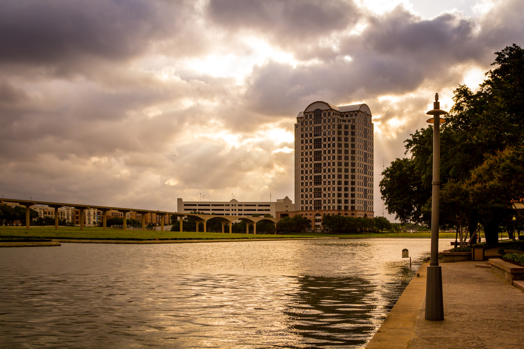 The sun rises over Lake Carolyn in Las Colinas, Irving, Texas.