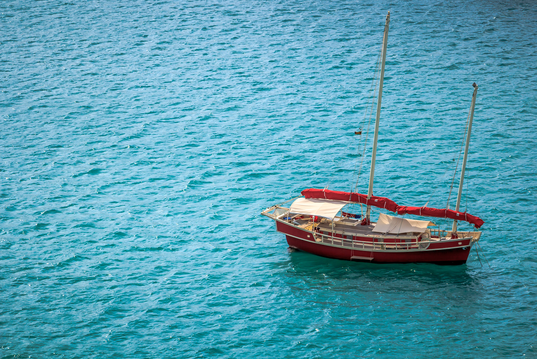 A red sailboat spotted at Montego Bay, Jamaica.