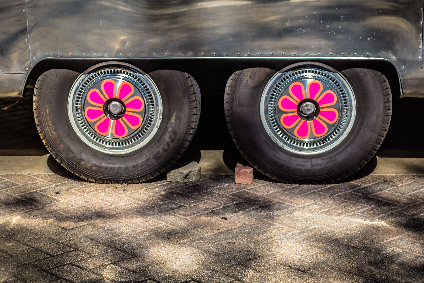 Decorated wheels on an Airstream caravan used as a food truck by Trailercakes spotted in the Dallas Arts District.