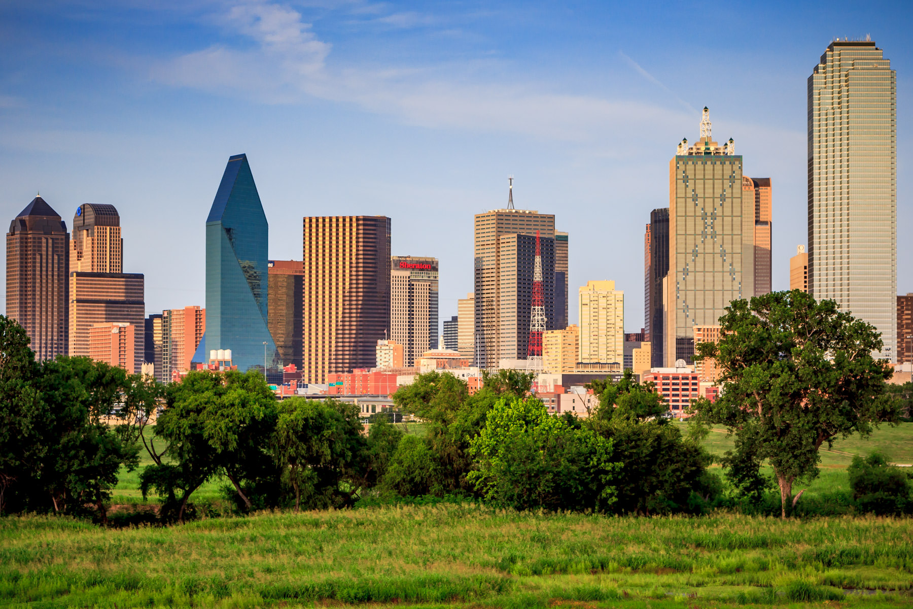 The Dallas skyline rises from the North Texas prairie as seen from the banks of the Trinity River west of downtown.