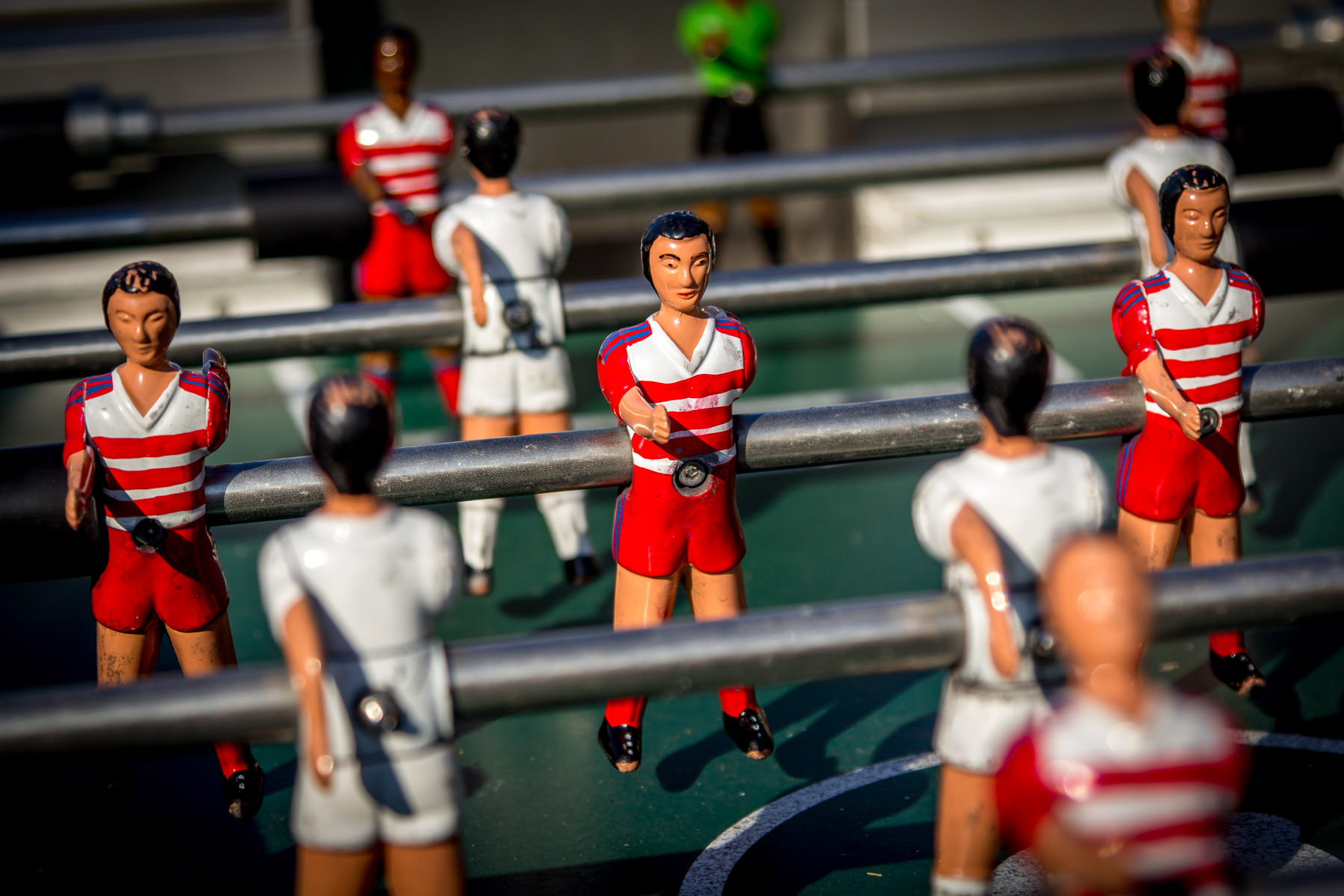 "Detail of some of the ""players"" on a table football (soccer) game (or ""foosball"") set at Dallas' Klyde Warren Park."