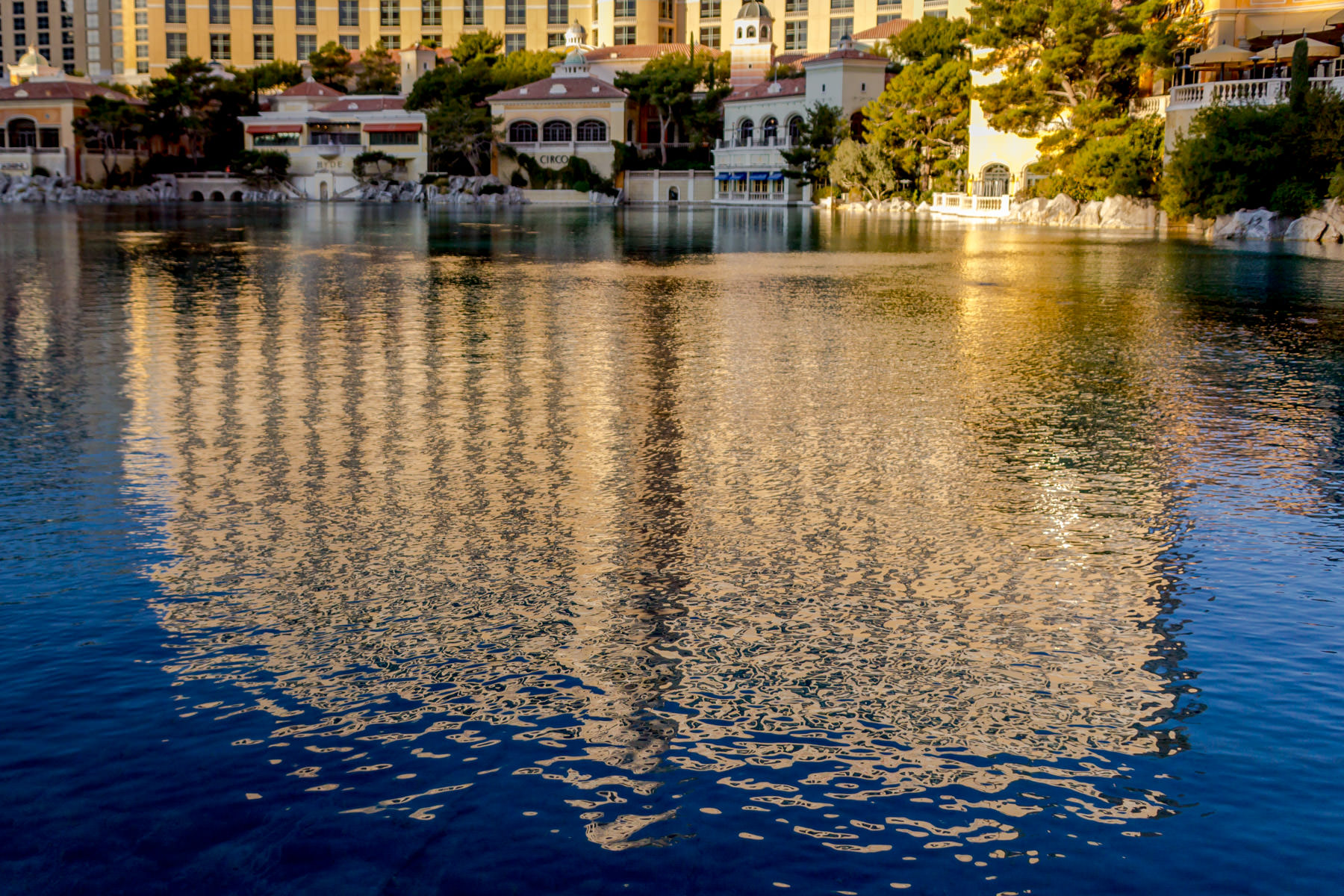 The main hotel tower of Las Vegas' Bellagio, reflected in the 8-acre (3.2 ha) man-made lake that sits between the casino and The Strip.