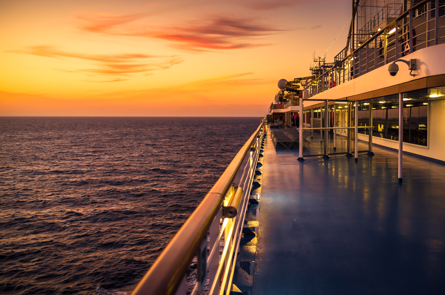 The golden light of the morning sun's first rays illuminates the cruise ship Carnival Magic somewhere in the Gulf of Mexico.