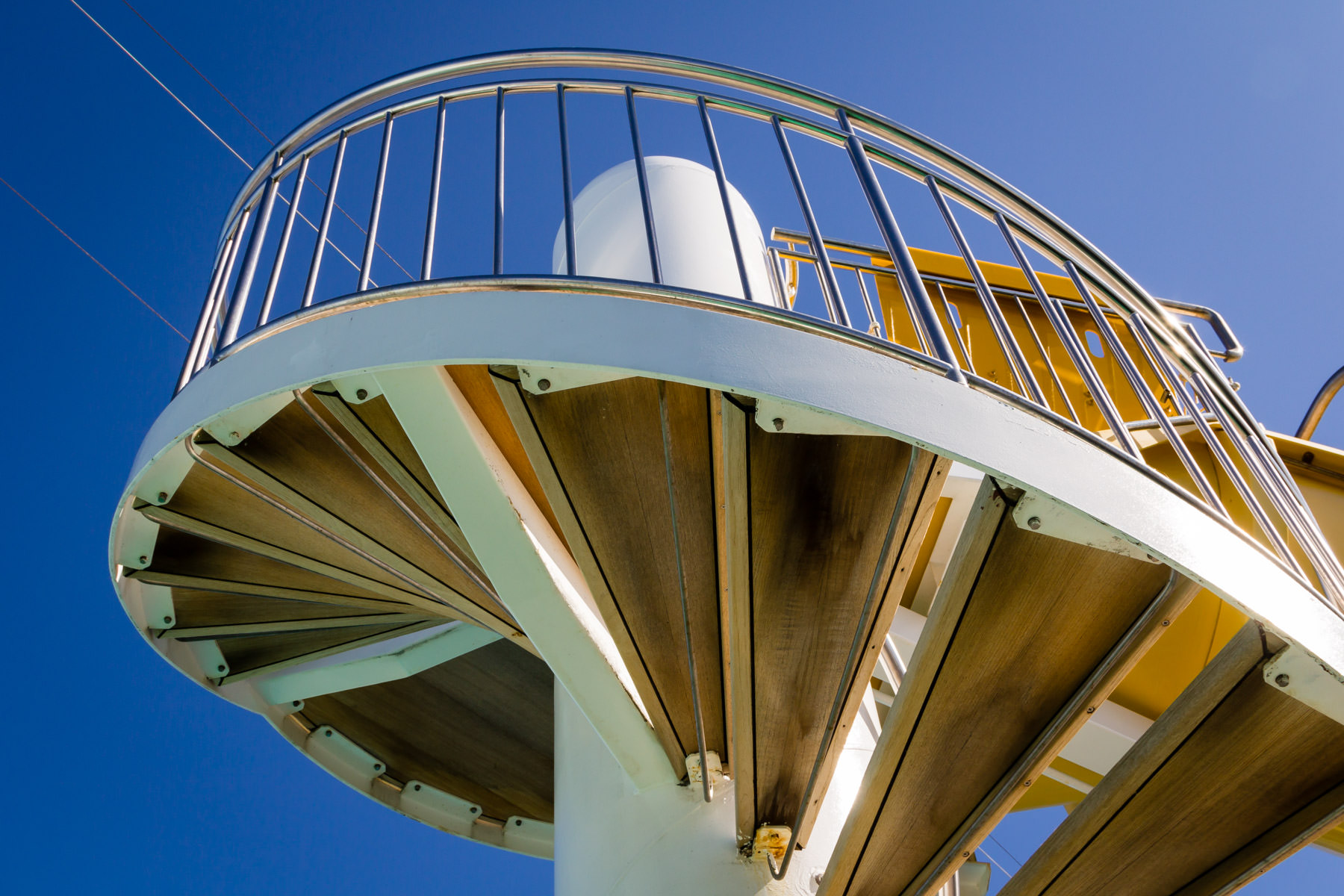 A spiral staircase leading to the top of a water slide aboard the cruise ship Norwegian Pearl.