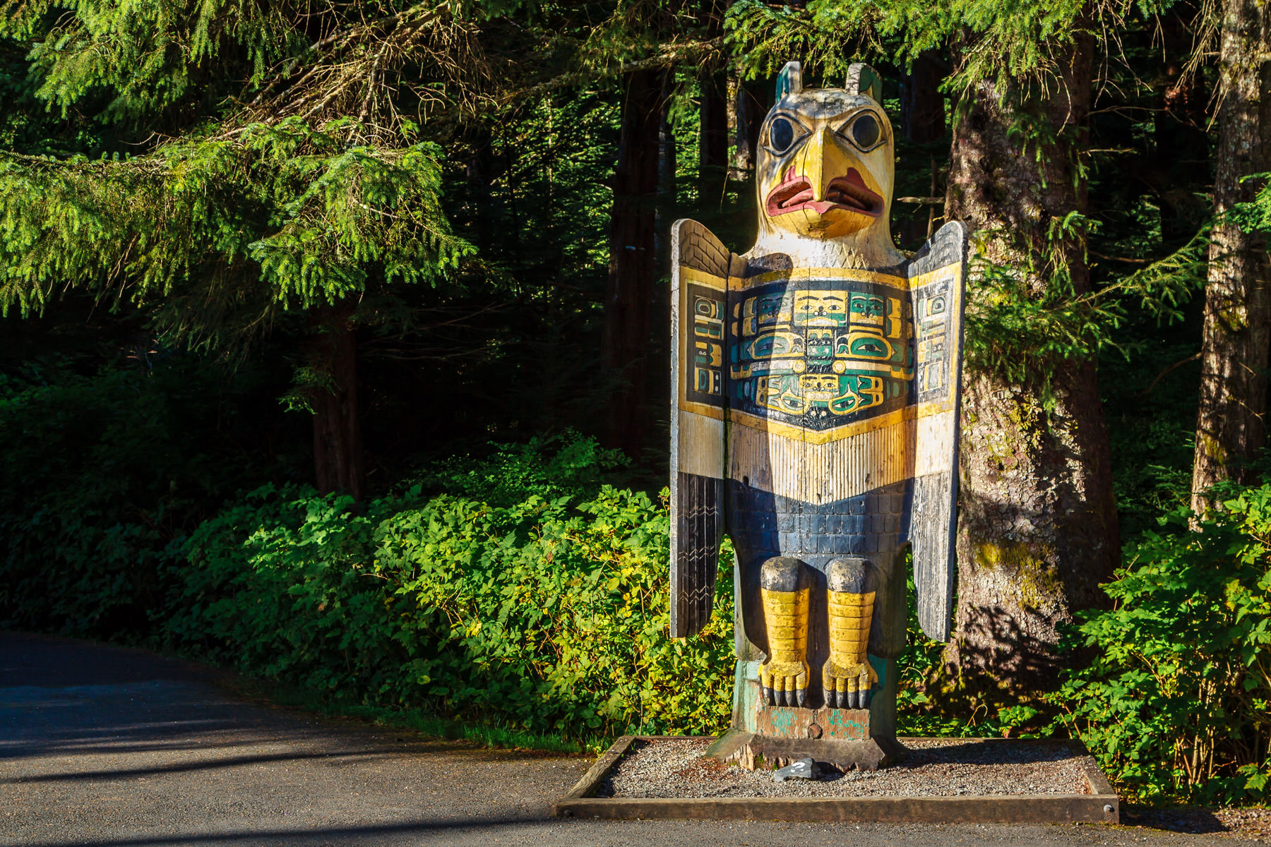 A grave marker totem pole in the shape of an eagle at Totem Bight State Park, Ketchikan, Alaska.