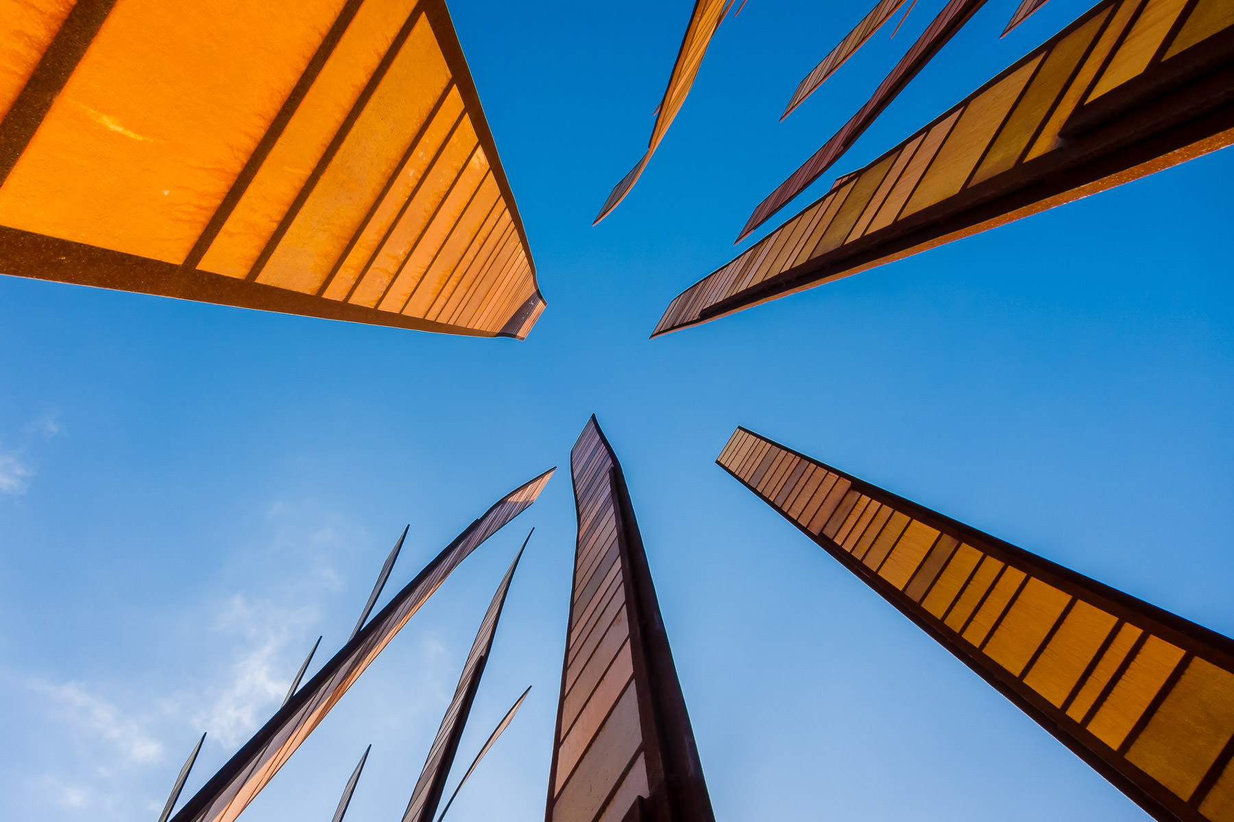 Grass Blades, a sculpture adjacent to the Experience Music Project, rises into the blue sky of Seattle.
