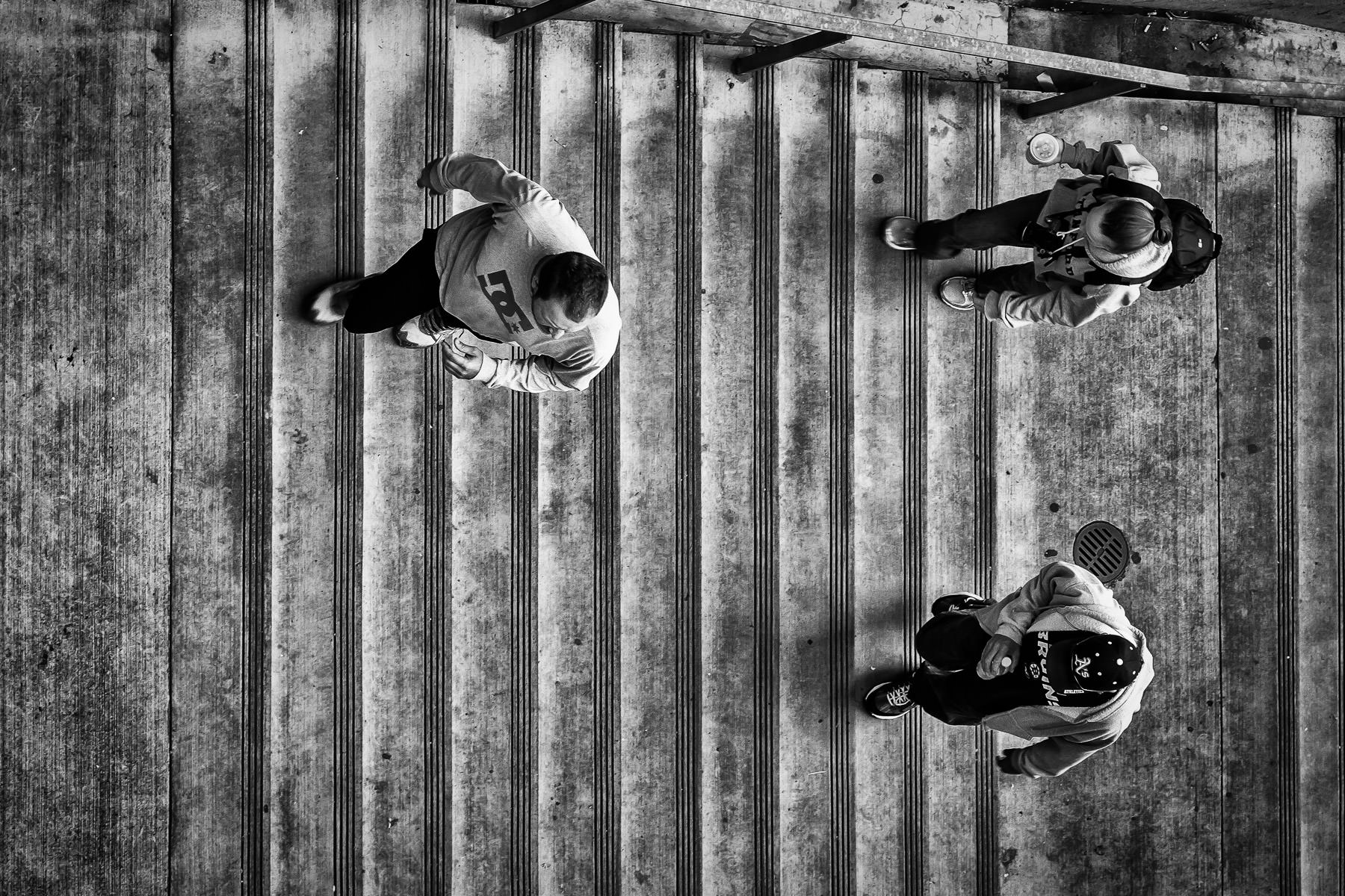Three people climb stairs at Seattle's Pike Place Market.