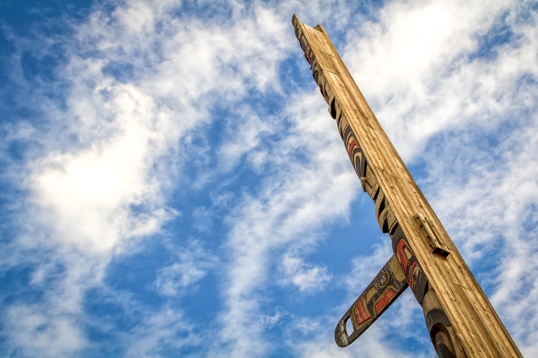 A totem pole rises into the sky over Seattle at Victor Steinbrueck Park, adjacent to the Pike Place Market.