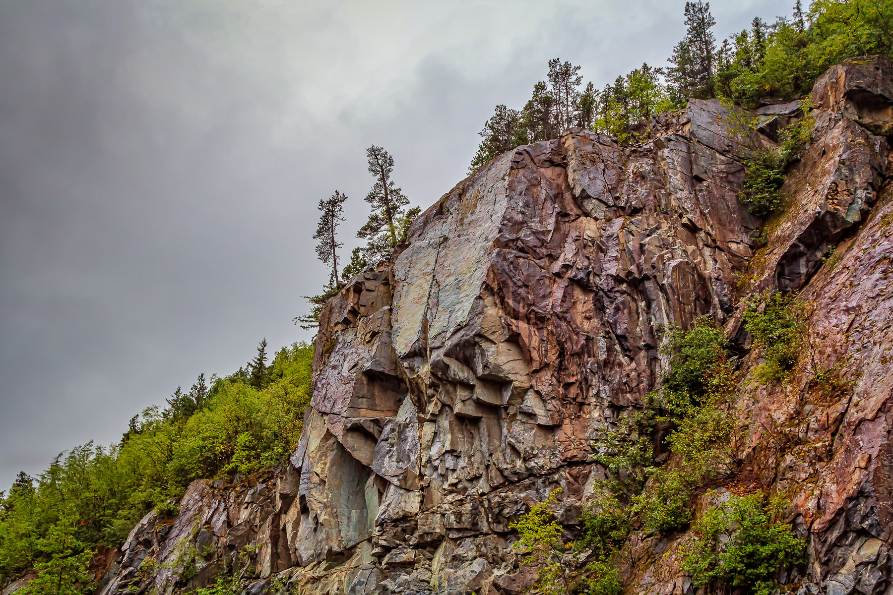A rocky cliff face high above the Klondike Highway, Alaska, just west of the border with British Columbia.