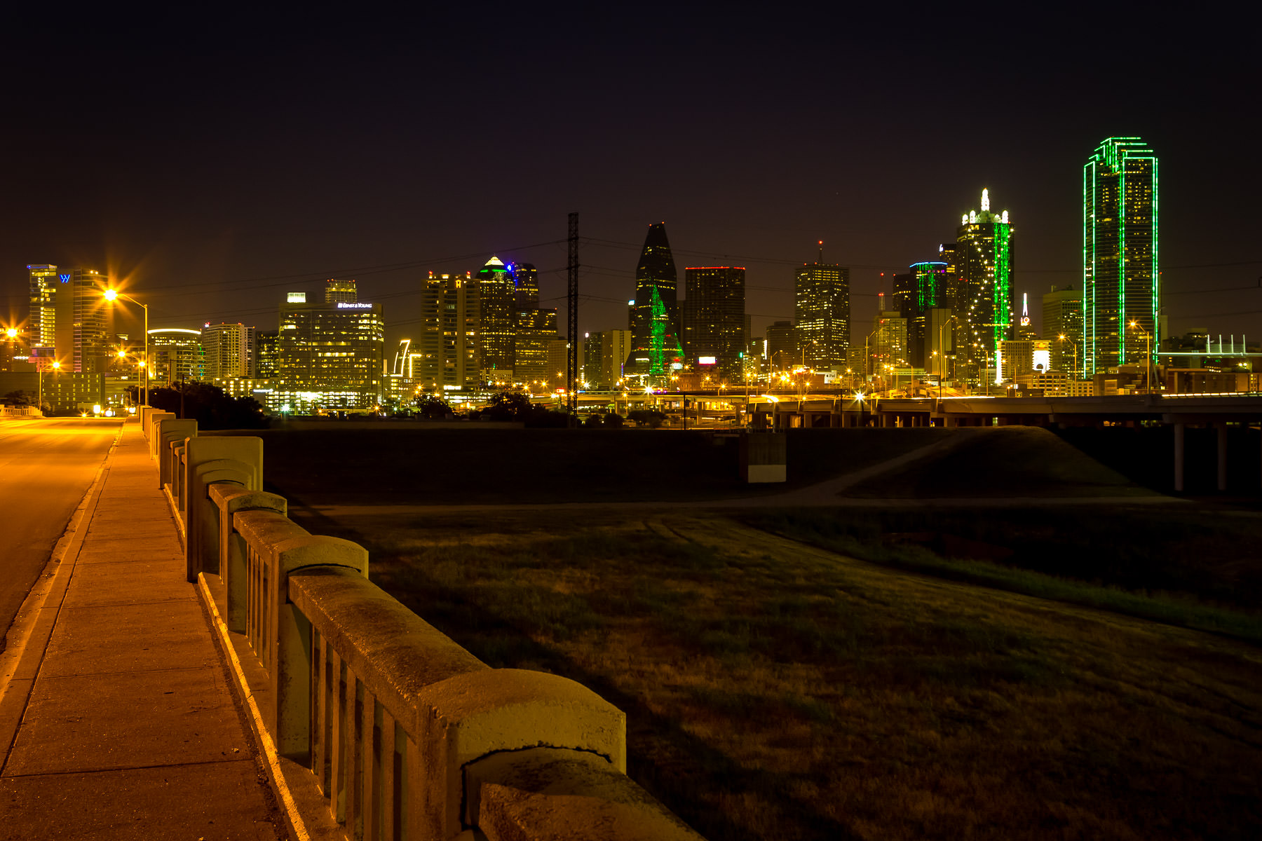 Dallas' distinctive skyline as seen from the Continental Avenue Bridge over the Trinity River floodplain.