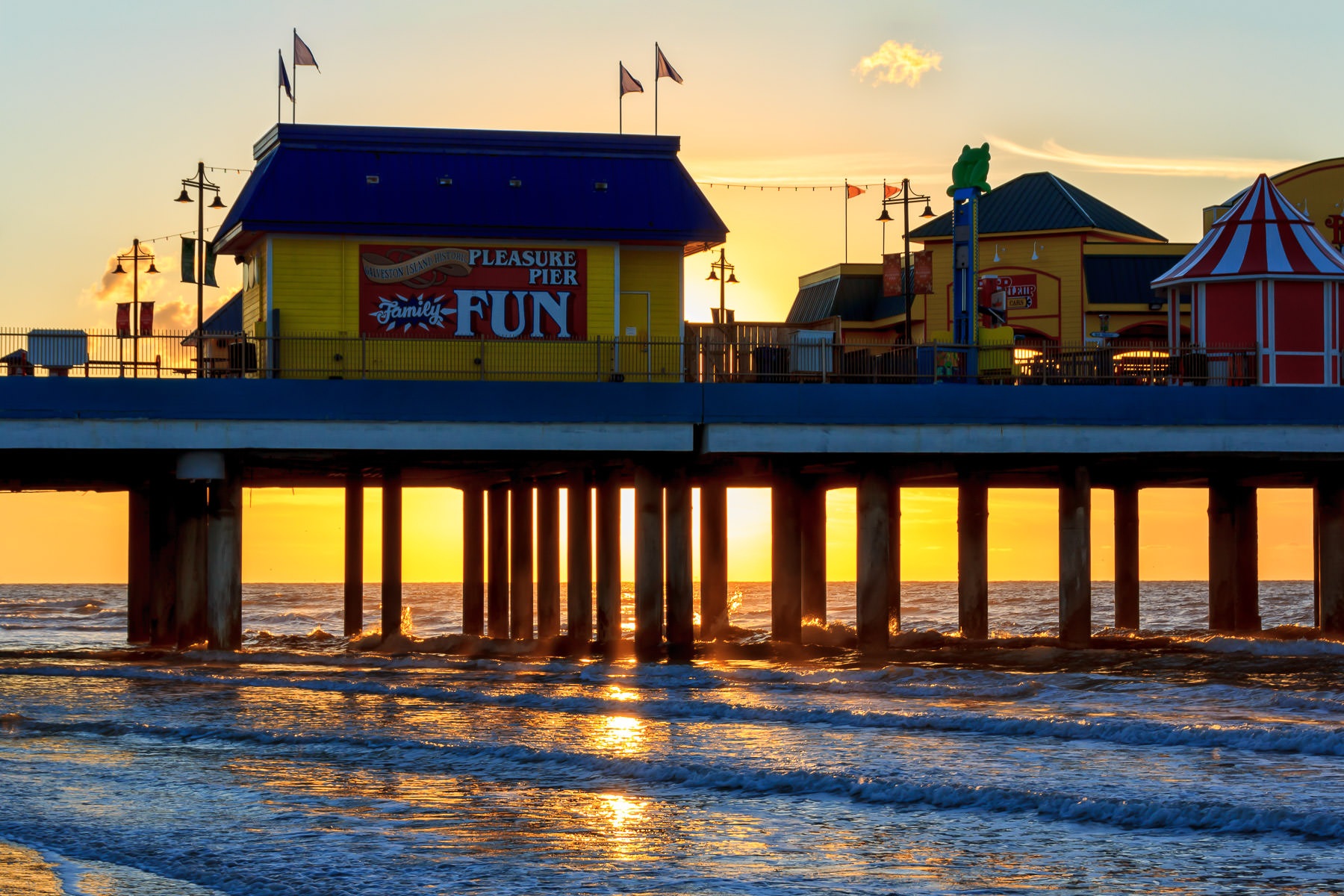The sun rises over the Gulf of Mexico behind Galveston, Texas' Pleasure Pier.