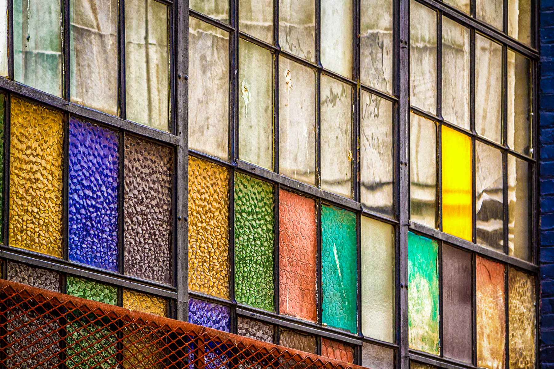 Multi-colored panes of glass in a window spotted in Downtown Seattle.