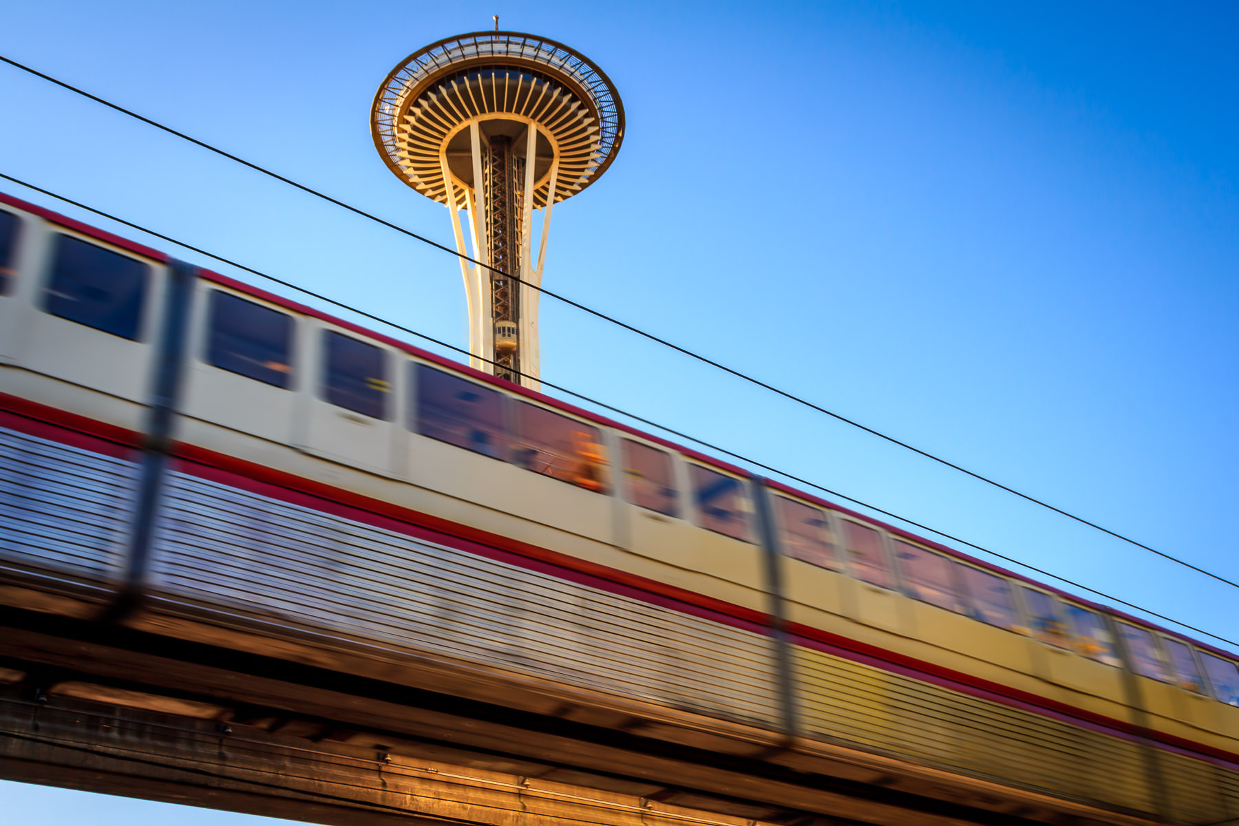 The Seattle Monorail speeds past the Space Needle on its route from the Seattle Center to the Westlake Center.