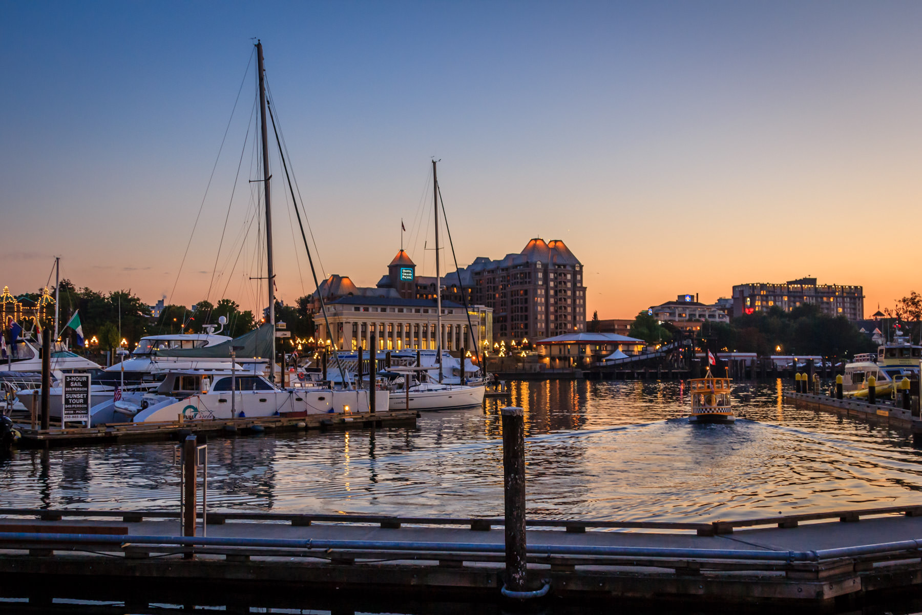The last rays of sunlight illuminate Victoria, British Columbia's Inner Harbour.
