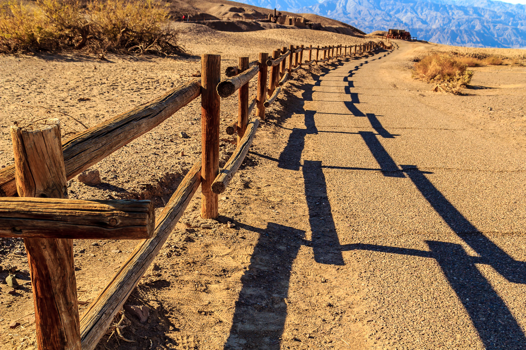 A fence winds into the distance in Death Valley National Park, California.