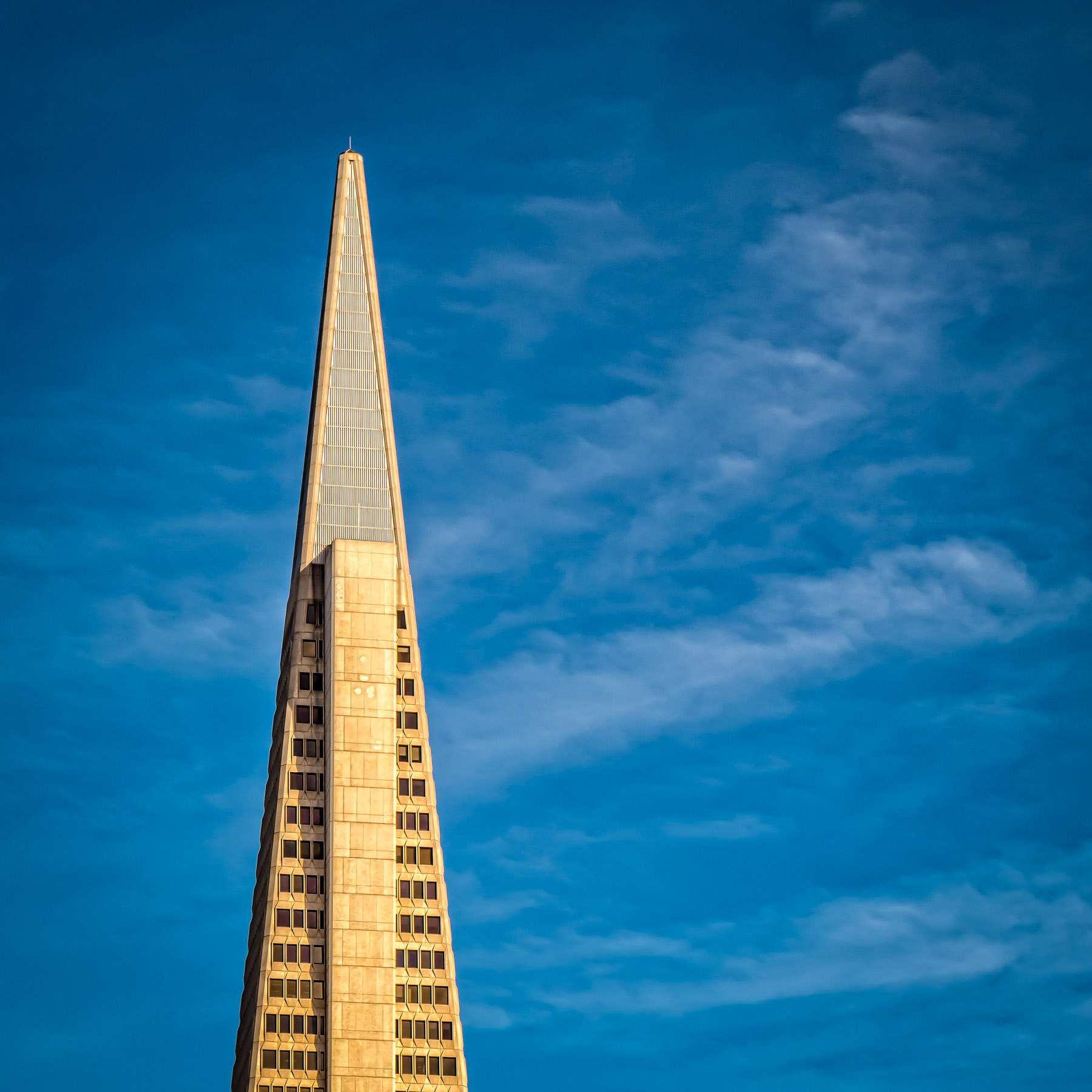 The Transamerica Pyramid rises into the azure sky over San Francisco.