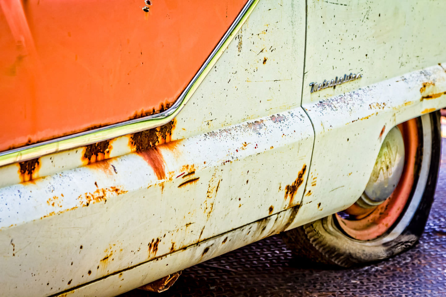 A decaying Nash Metropolitan sits on a trailer at Dallas' All British and European Car Day, awaiting eventual restoration.
