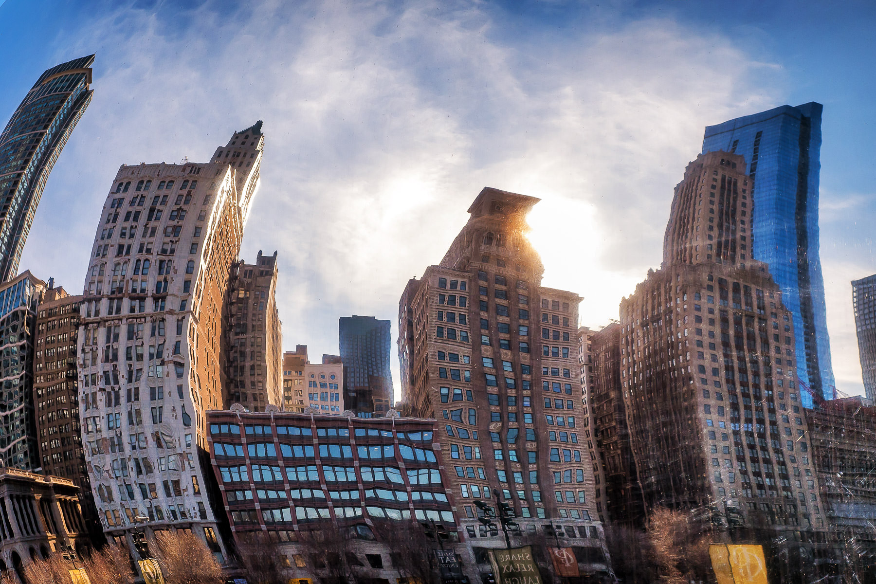 """A portion of Chicago's skyline is bent and twisted as it reflects in the polished steel skin of Anish Kapoor's Cloud Gate, colloquially known as """"The Bean"""", in Millennium Park."""