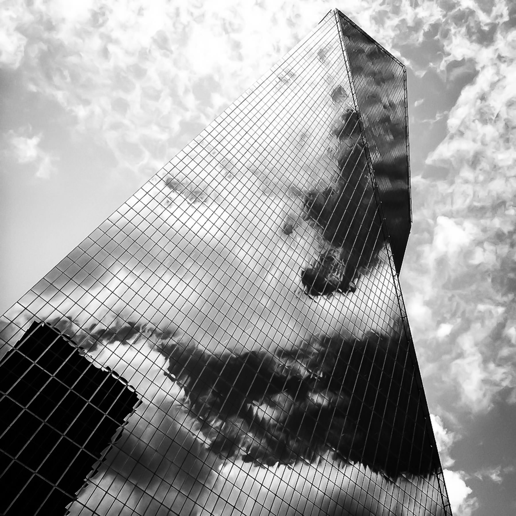 Dallas' Fountain Place tower rises into the cloudy Texas sky.