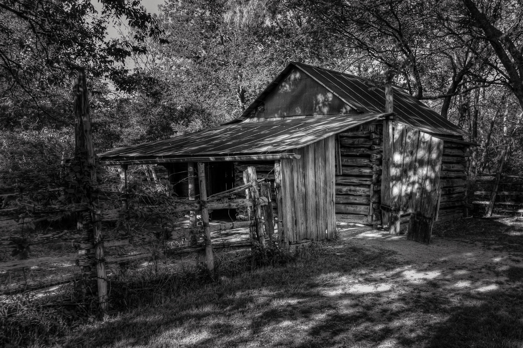 An ancient wooden barn slowly rots at Penn Farm in Cedar Hill State Park, Texas.
