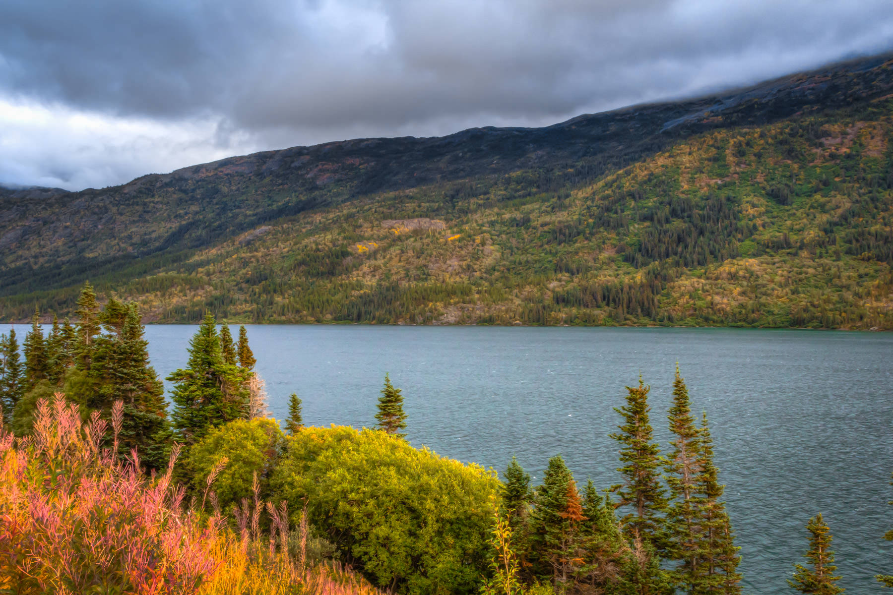 Storm clouds begin to form over Tutshi Lake in the low mountains near Carcross, Yukon Territory, Canada.