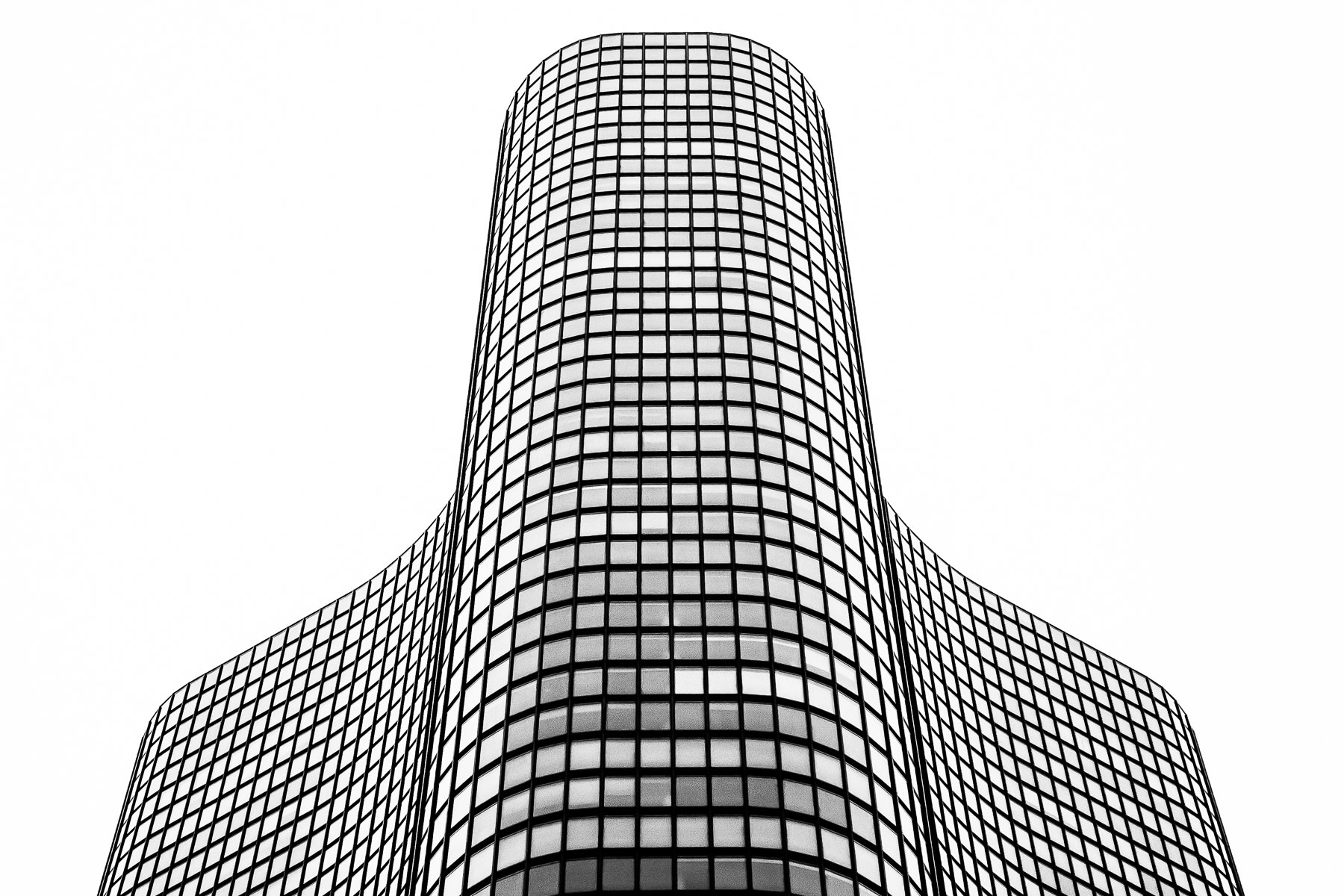 The graceful curves of Lake Point Tower rise into the overcast Chicago sky.