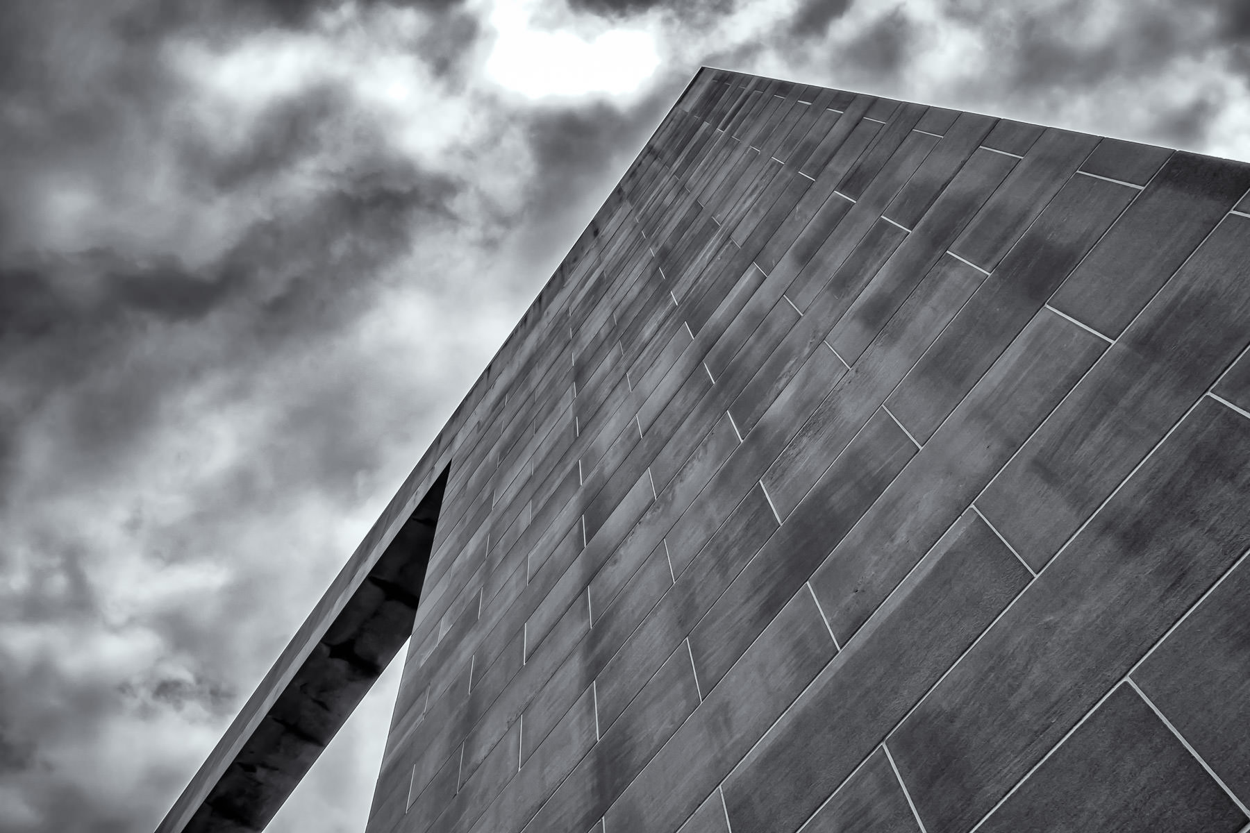 The Emery Reves Arch of Peace rises into the cloudy sky at the Meyerson Symphony Center in the Dallas Arts District.