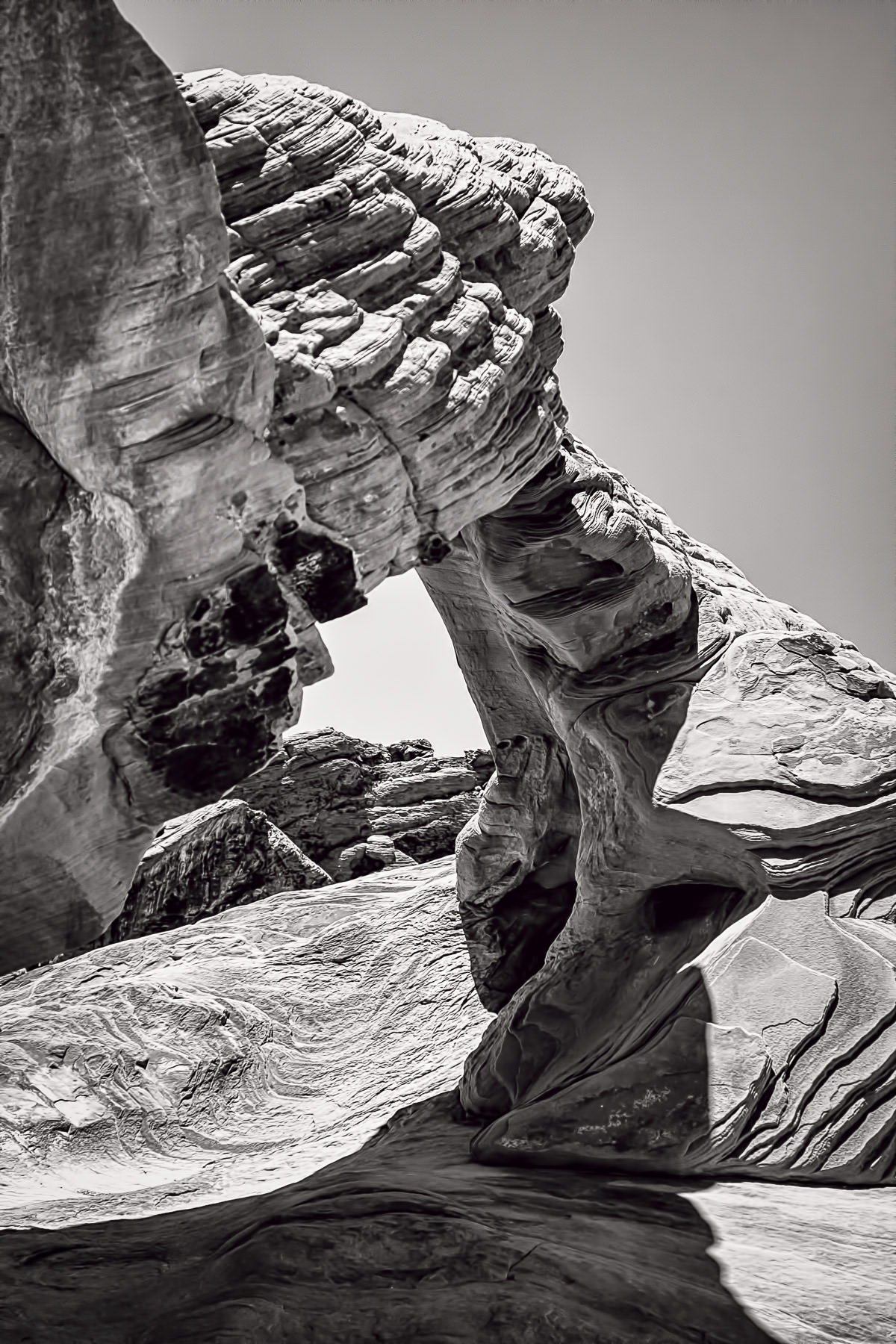 A rock arch rises from the desert landscape at Nevada's Valley of Fire State Park.