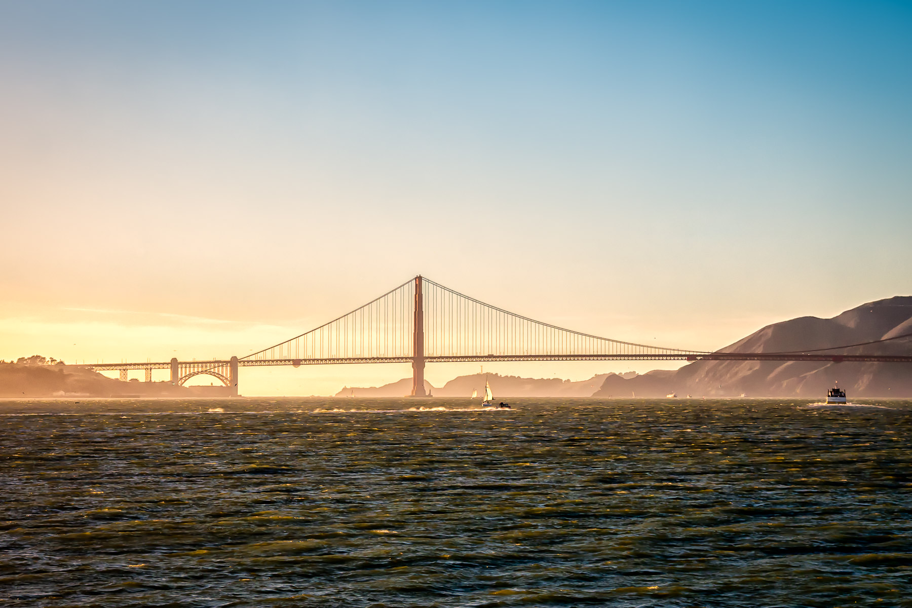 The early evening sun lights the south tower of San Francisco's iconic Golden Gate Bridge.
