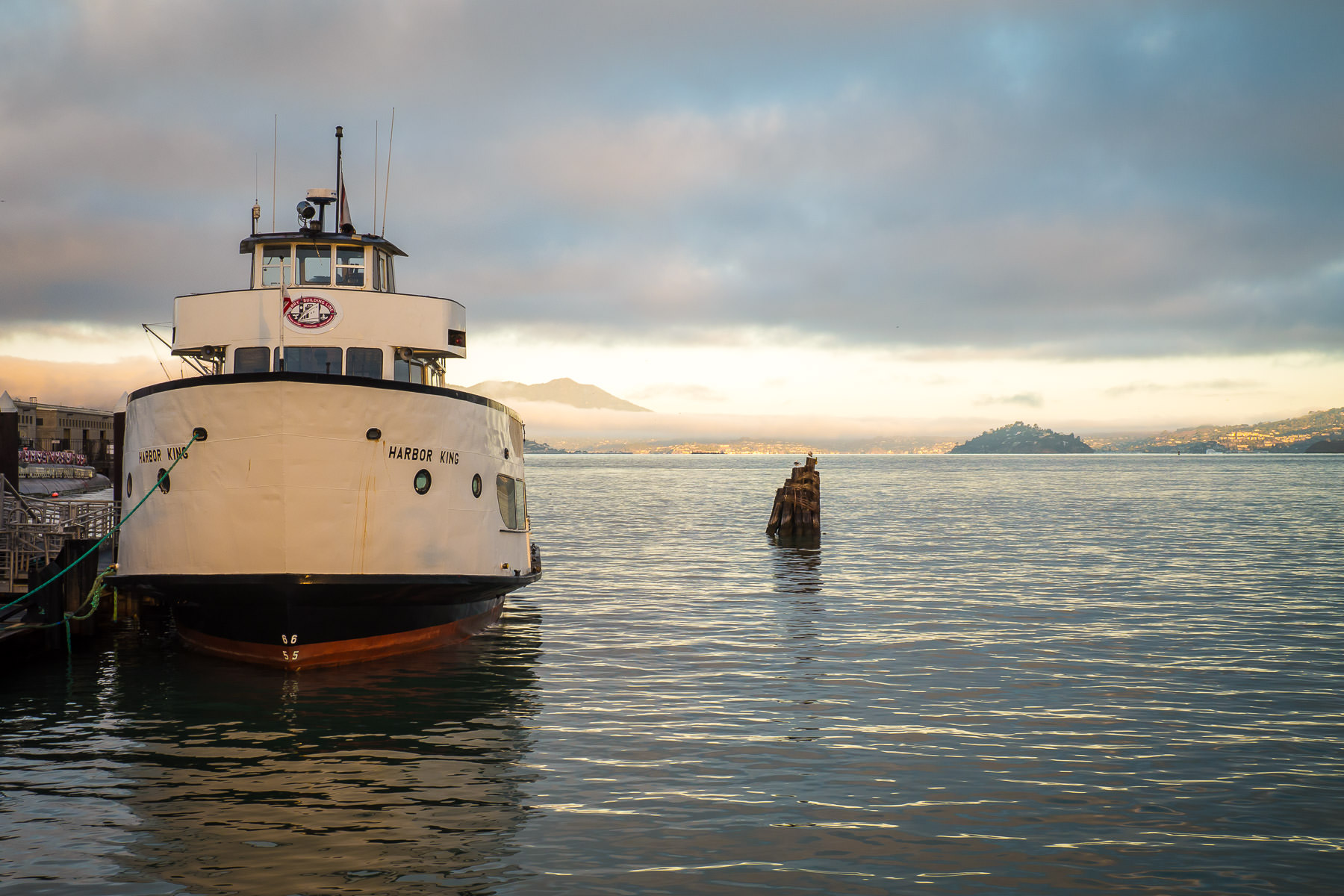 The Red and White Fleet's Harbor King sits quietly at her berth just after sunrise at San Francisco's Fisherman's Wharf.
