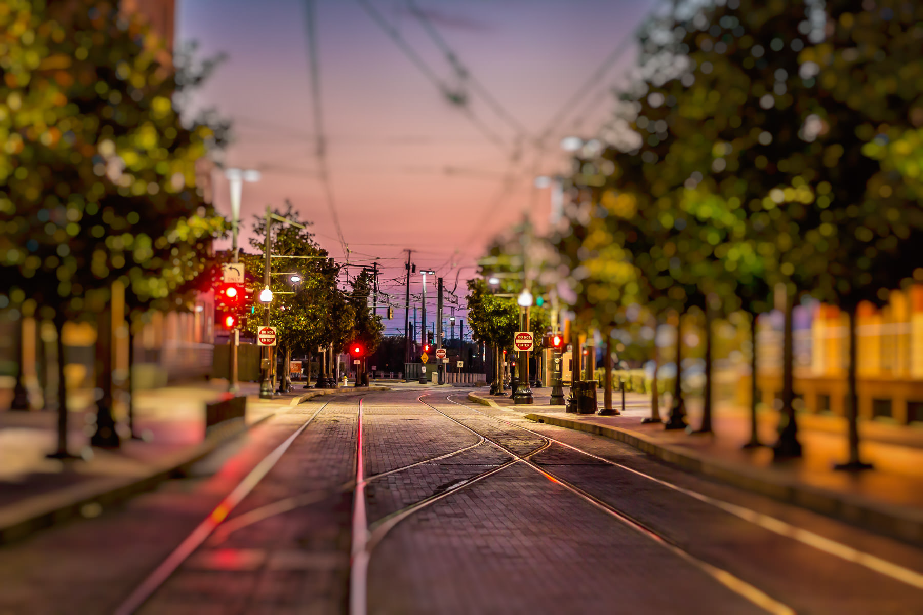 DART Rail tracks in Dallas' West End district as the sun sets over North Texas.