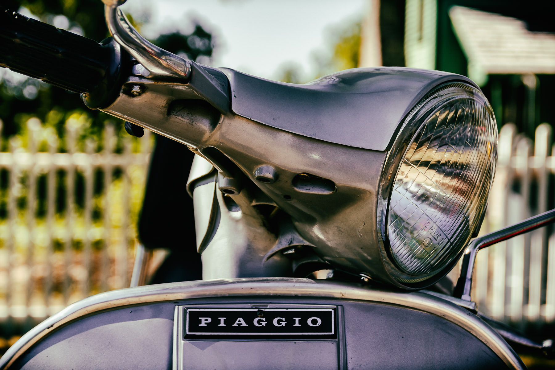 Detail of a Piaggio Vespa scooter at ItalianCarFest in Grapevine, Texas.