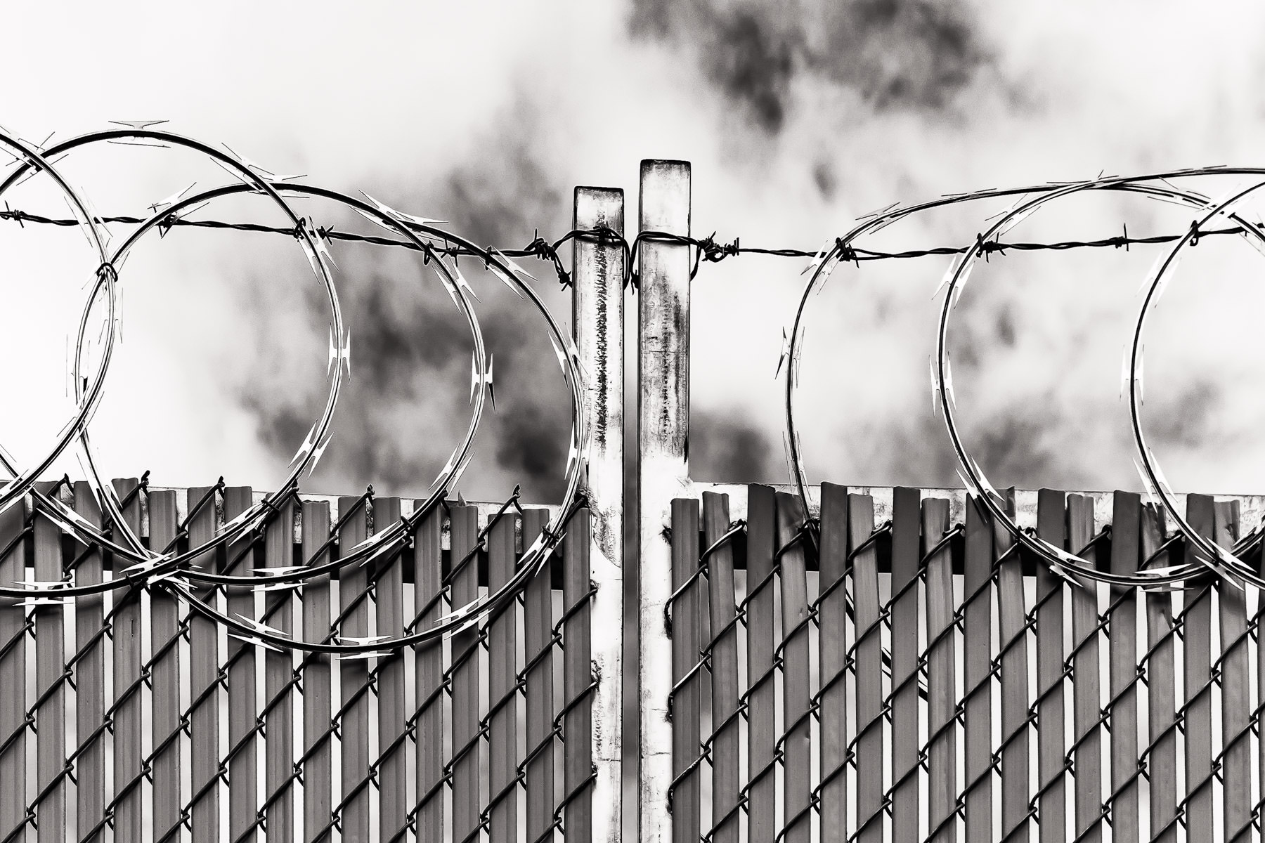 Coils of concertina wire top a fence in Dallas' Deep Ellum neighborhood.