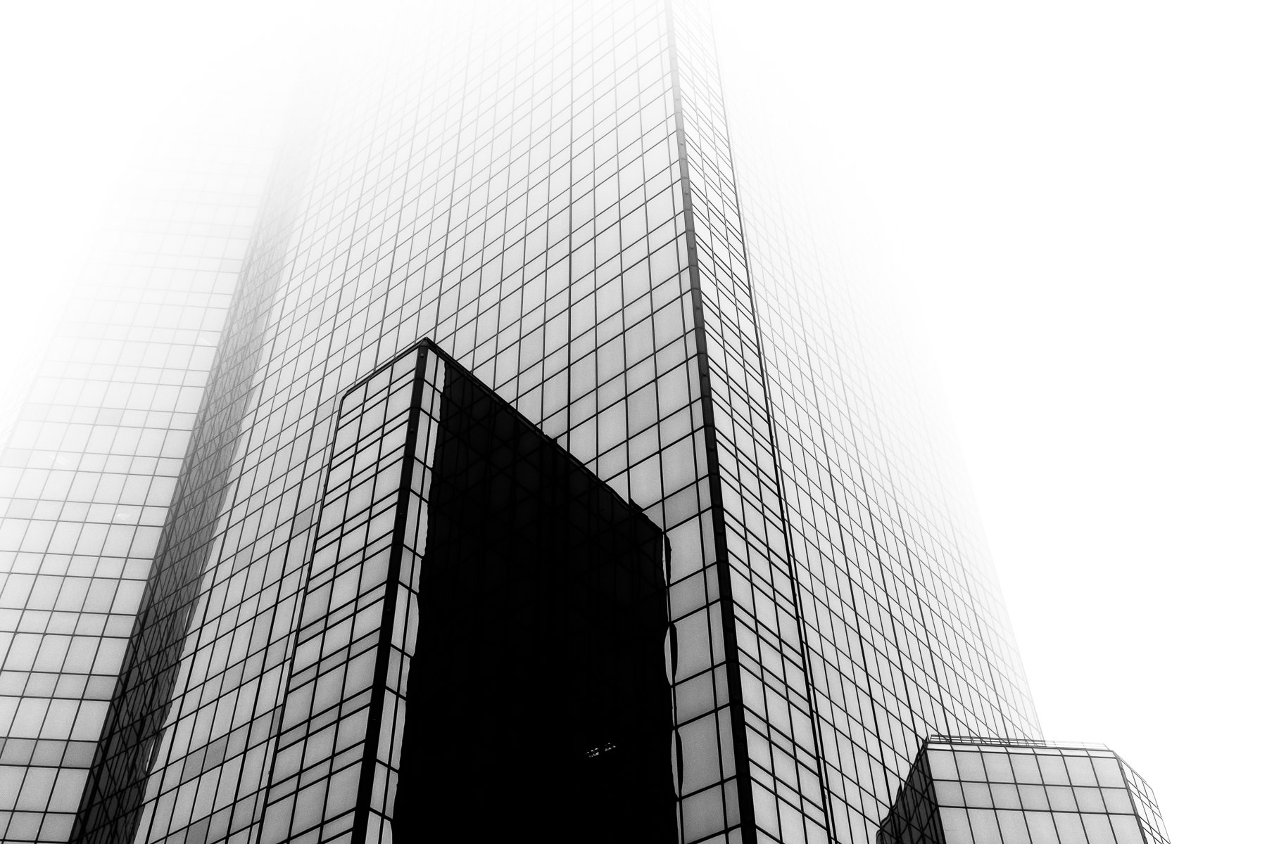One of the skyscrapers of Fort Worth, Texas' City Center Towers Complex rises into the foggy North Texas sky.