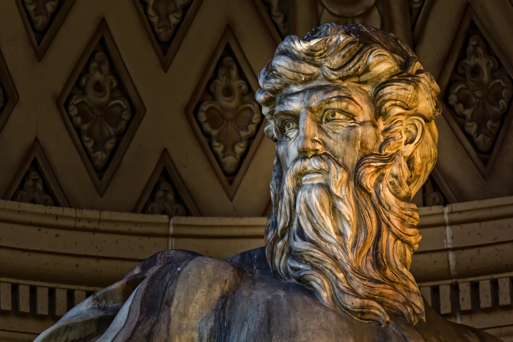 Detail of a statue of the Roman god of the sea, Neptune, part of a replica of Rome's Trevi Fountain at Caesars Palace, Las Vegas.