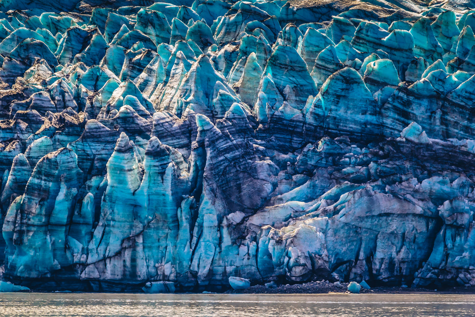 Layers of ice showing the passage of time in the 250-foot-tall face of Alaska's Margerie Glacier at Glacier Bay National Park.