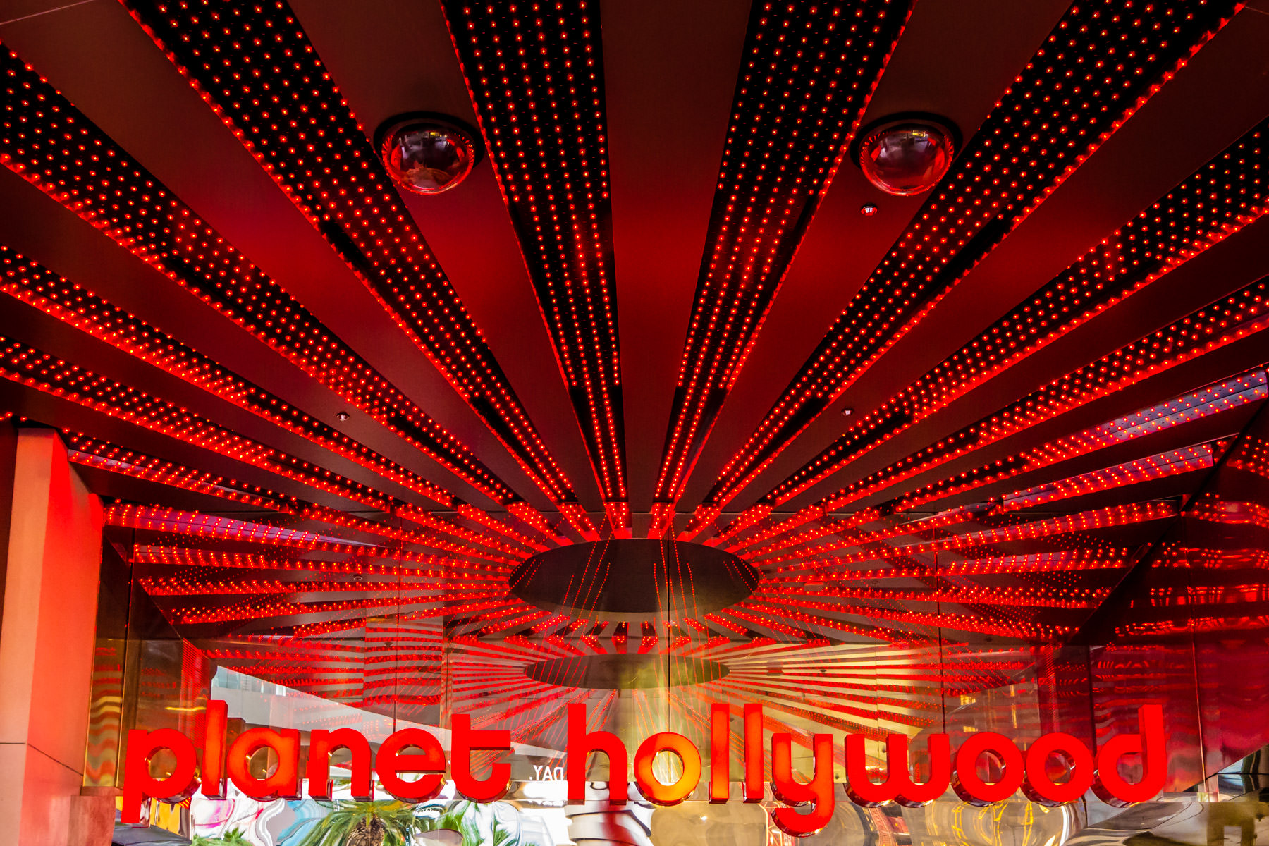 Detail of an entryway and accompanying sign at Planet Hollywood Resort and Casino in Las Vegas.