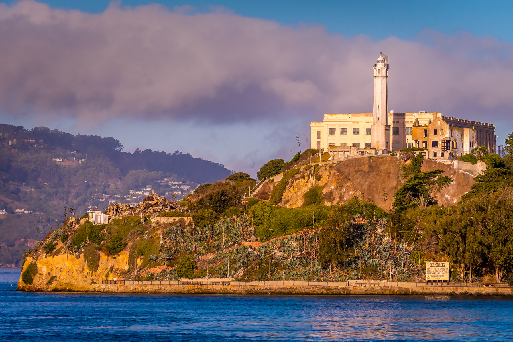 Alcatraz Federal Penitentiary rises from San Francisco Bay to catch the first light of the morning sun.