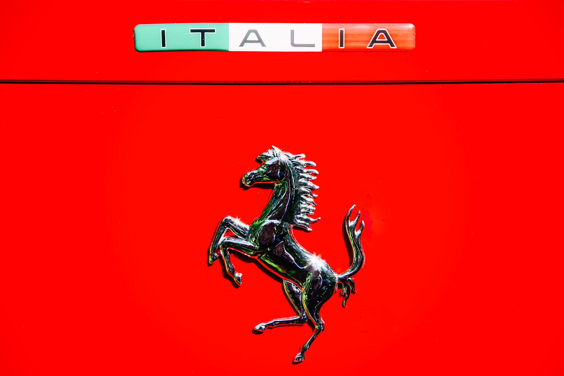 Ferrari's iconic Prancing Stallion, or Cavallino Rampante, as seen on a Ferrari 328 GTB at Dallas' Cooper Aerobics Center's Autos in the Park event.
