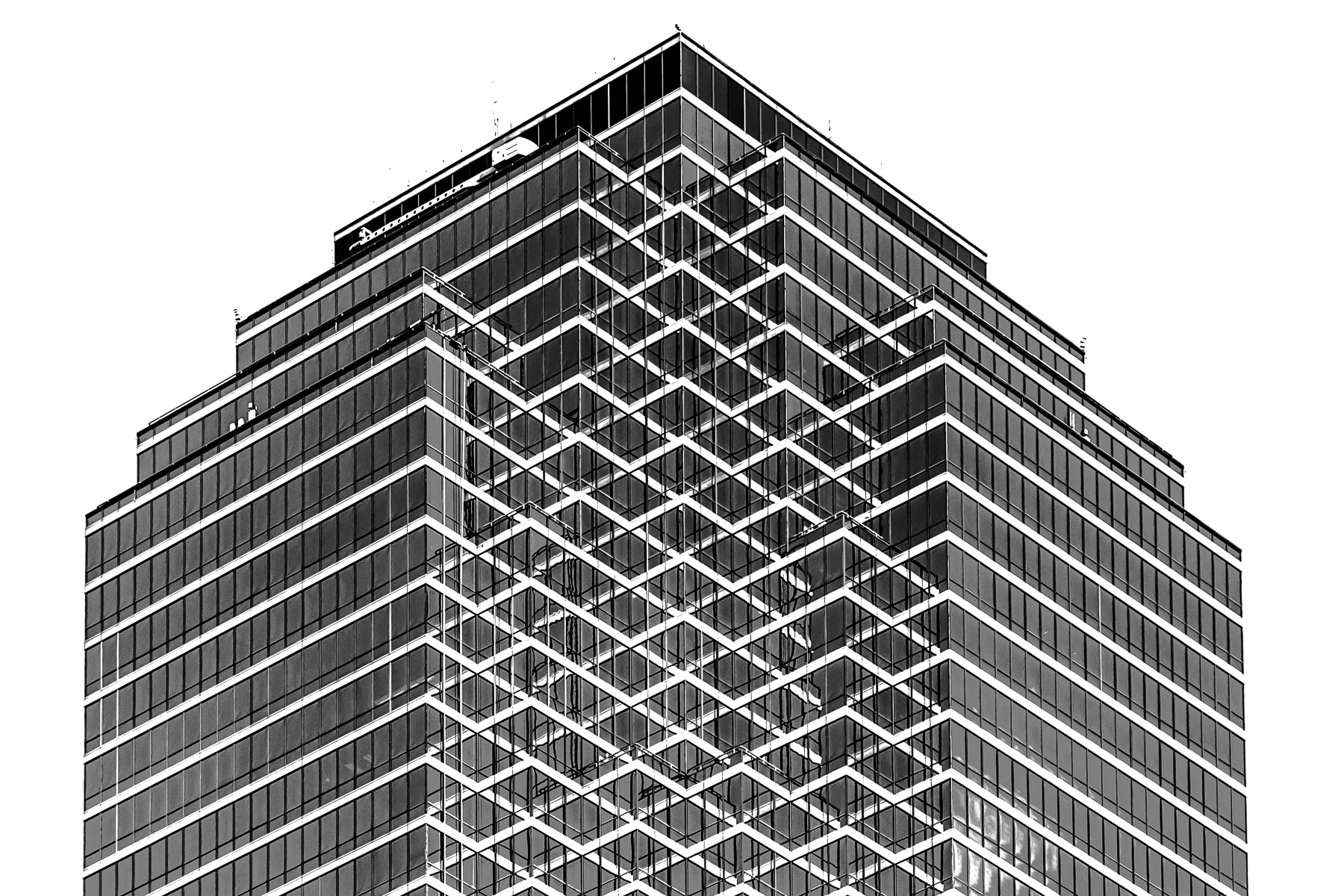 Architectural detail of the top of Bank of America Plaza in Downtown Dallas.