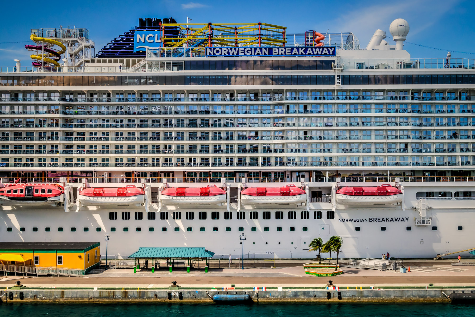 Detail of the midsection of the cruise ship Norwegian Breakaway, docked at a pier in Nassau, Bahamas.