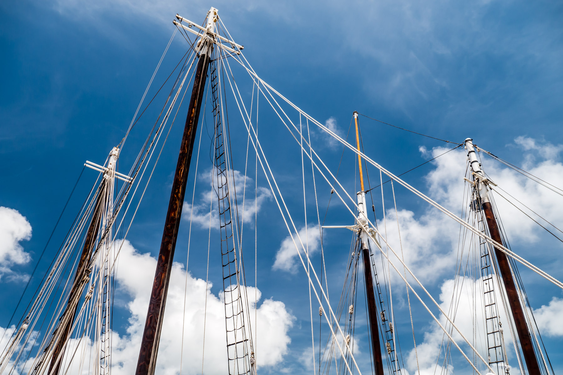 Sailboat masts rise into the blue Florida sky at Key West Harbor.
