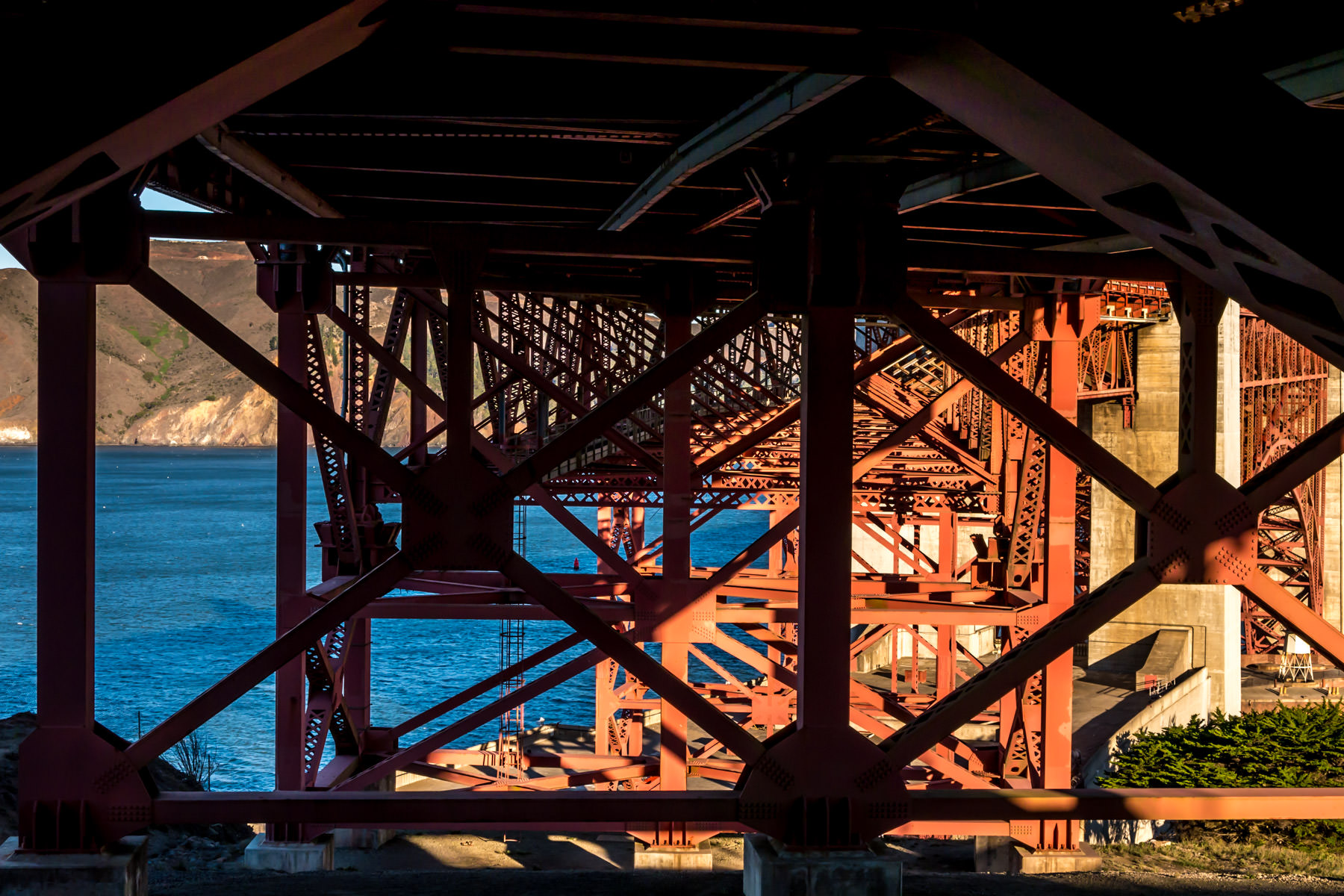 Detail of the support structure of San Francisco's iconic Golden Gate Bridge as it spans its namesake narrows between San Francisco Bay and the Pacific Ocean.