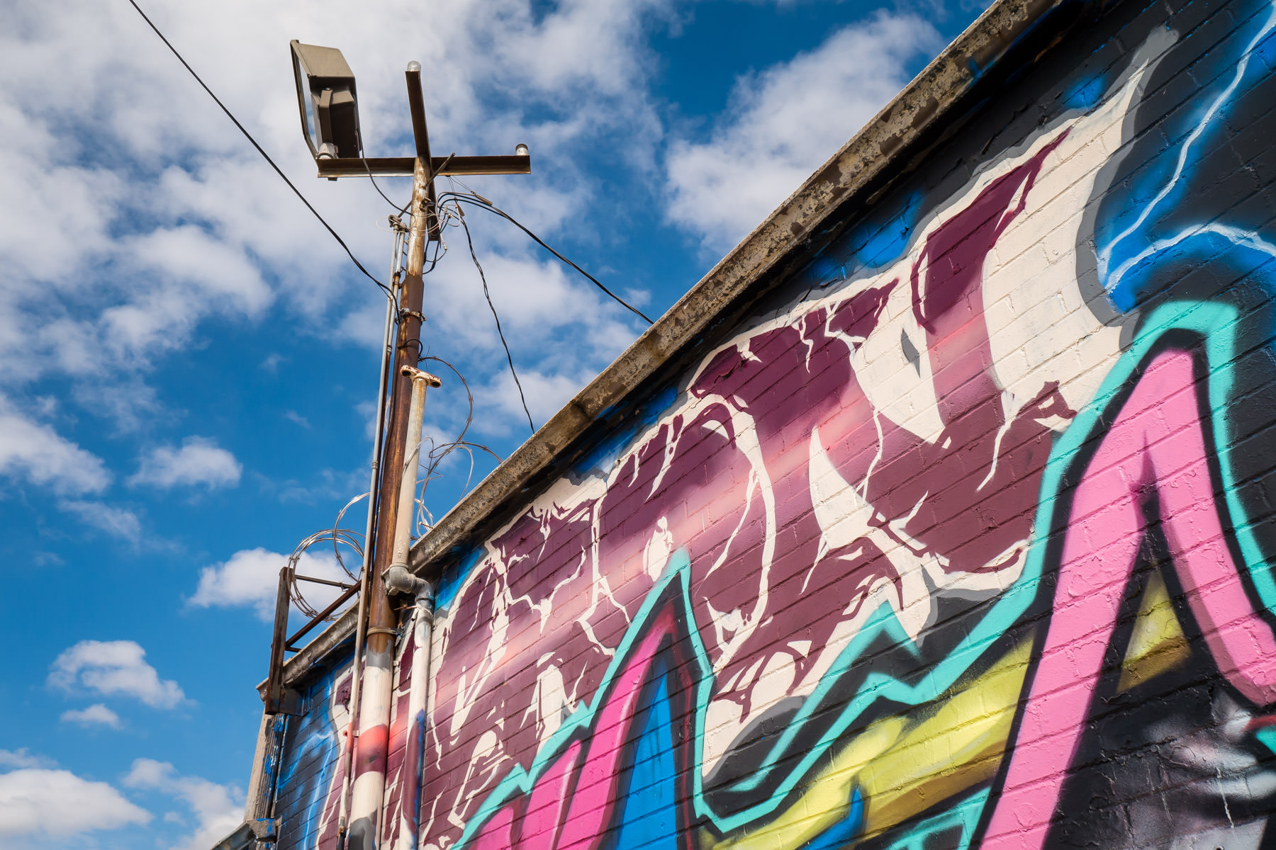 An indecipherable graffiti mural found on a building in Dallas' Deep Ellum neighborhood.